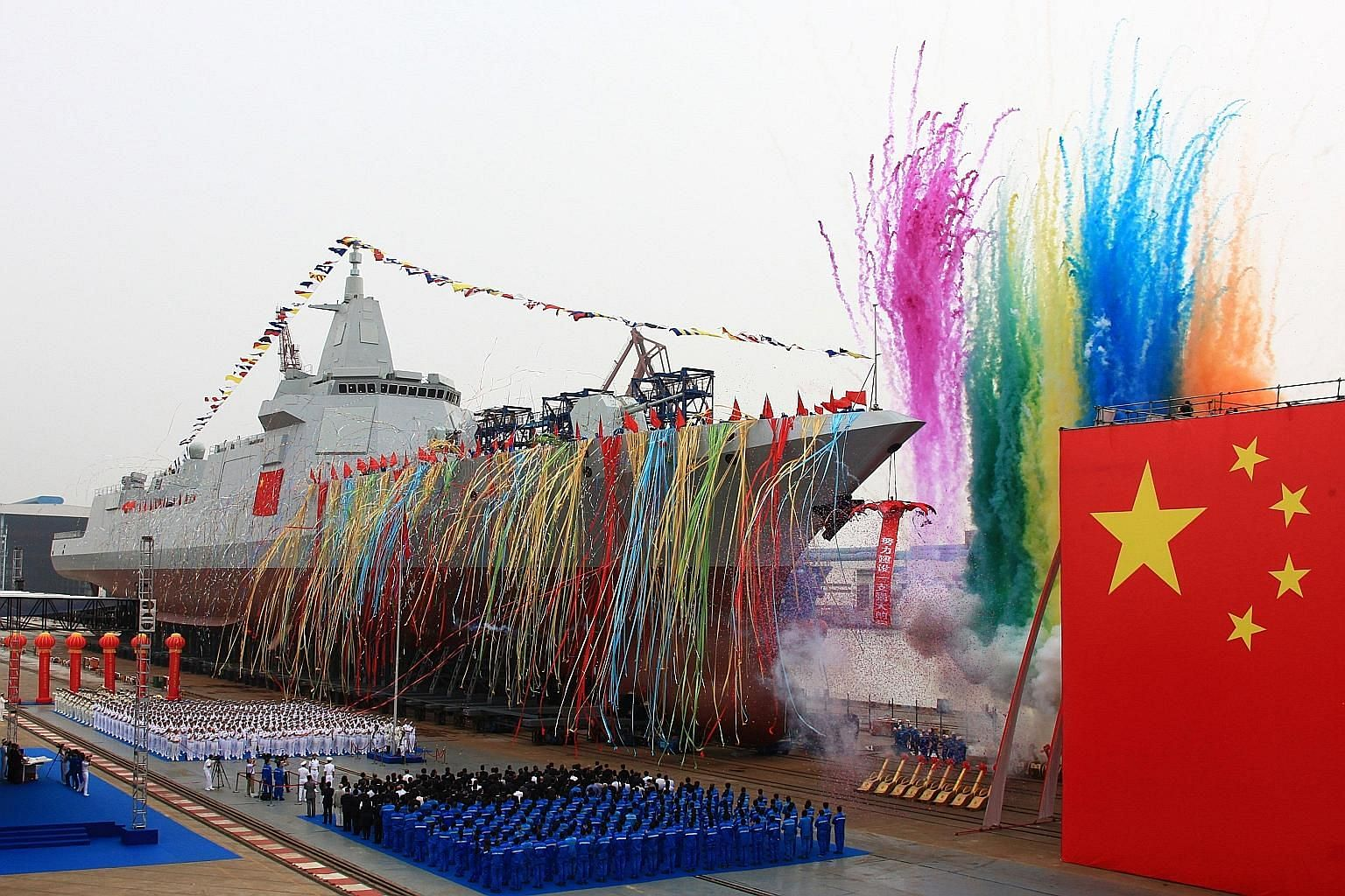 China's new 10,000-ton warship being launched at Jiangnan Shipyard in Shanghai yesterday. Said to be the first Type 055 destroyer, it is equipped with new air defence, anti-missile, anti-ship and anti-submarine weapons.