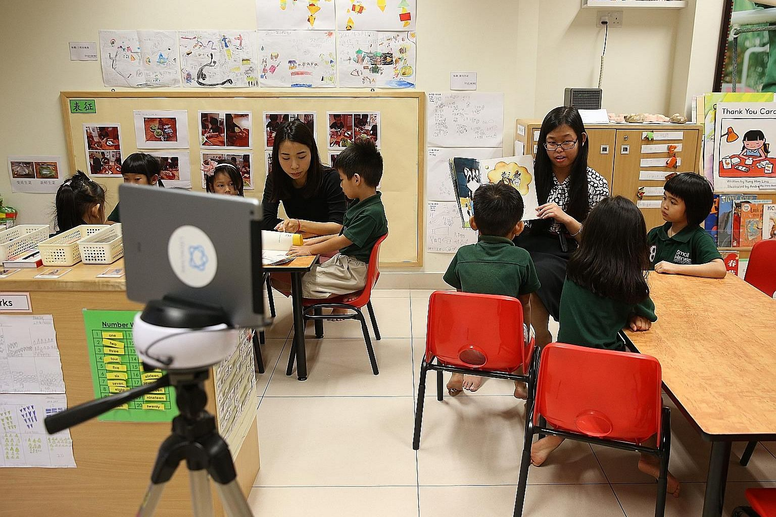 An iPad recording a K2 class to document the activities and developmental progress of children, so that the information can be shared with parents. This is part of the suite of IT solutions offered by the Smart Solutions initiative which will help ra