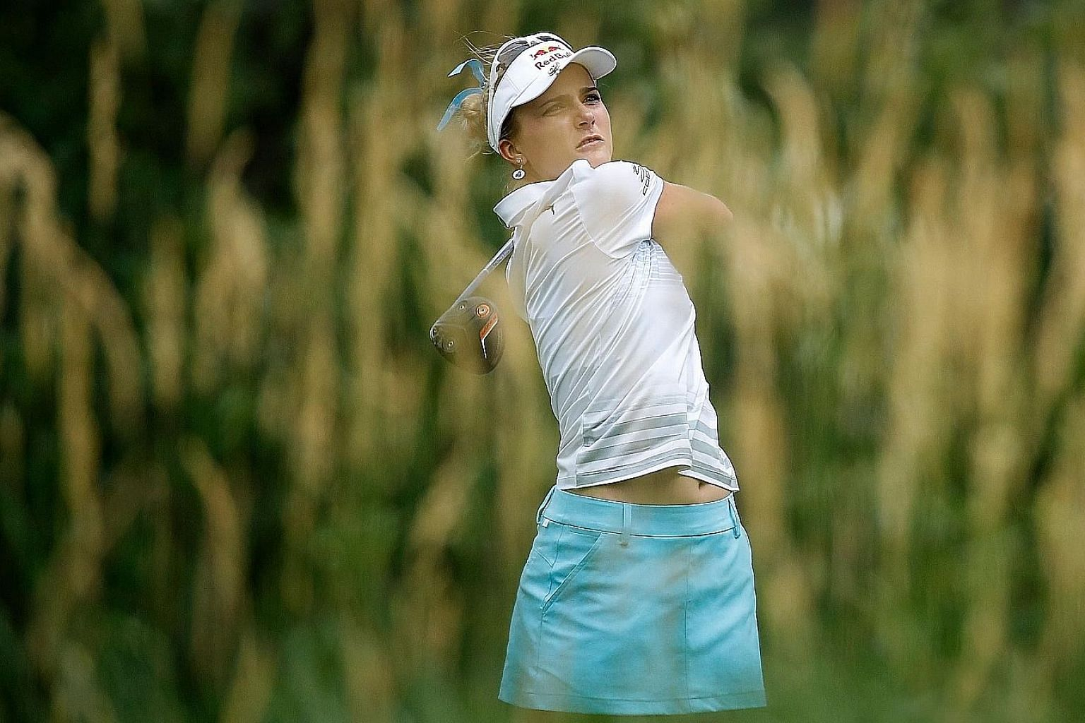 Lexi Thompson teeing off at the 16th hole during the opening round of the Women's PGA Championship. She mixed three birdies with two bogeys in her first round for a one-under 70.
