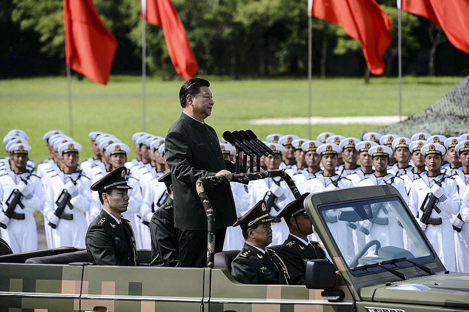 Chinese President Xi Jinping inspecting the People's Liberation Army Garrison in Hong Kong yesterday. Mr Xi will attend the investiture of new Chief Executive Carrie Lam and her government today.
