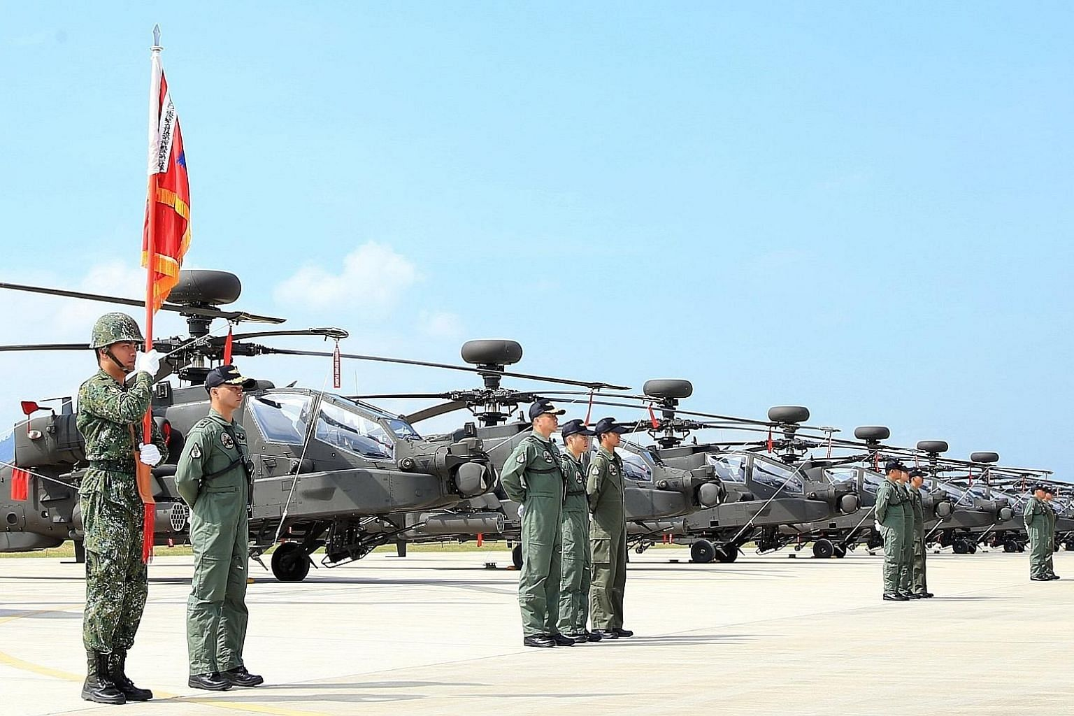 Apache attack helicopters being displayed in a ceremony at a military base in Taoyuan County, northern Taiwan, on Wednesday. The latest arms sales, announced on Thursday, comes just one day after a proposal by a US Senate panel to allow American wars