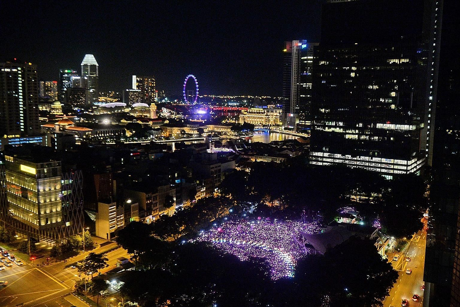The annual rally at Hong Lim Park yesterday saw 20,000 Singaporeans and permanent residents attending (above and below). Some from the LGBT community took to the stage to share their views. Pink Dot ambassadors - singer Nathan Hartono, paralympian Th