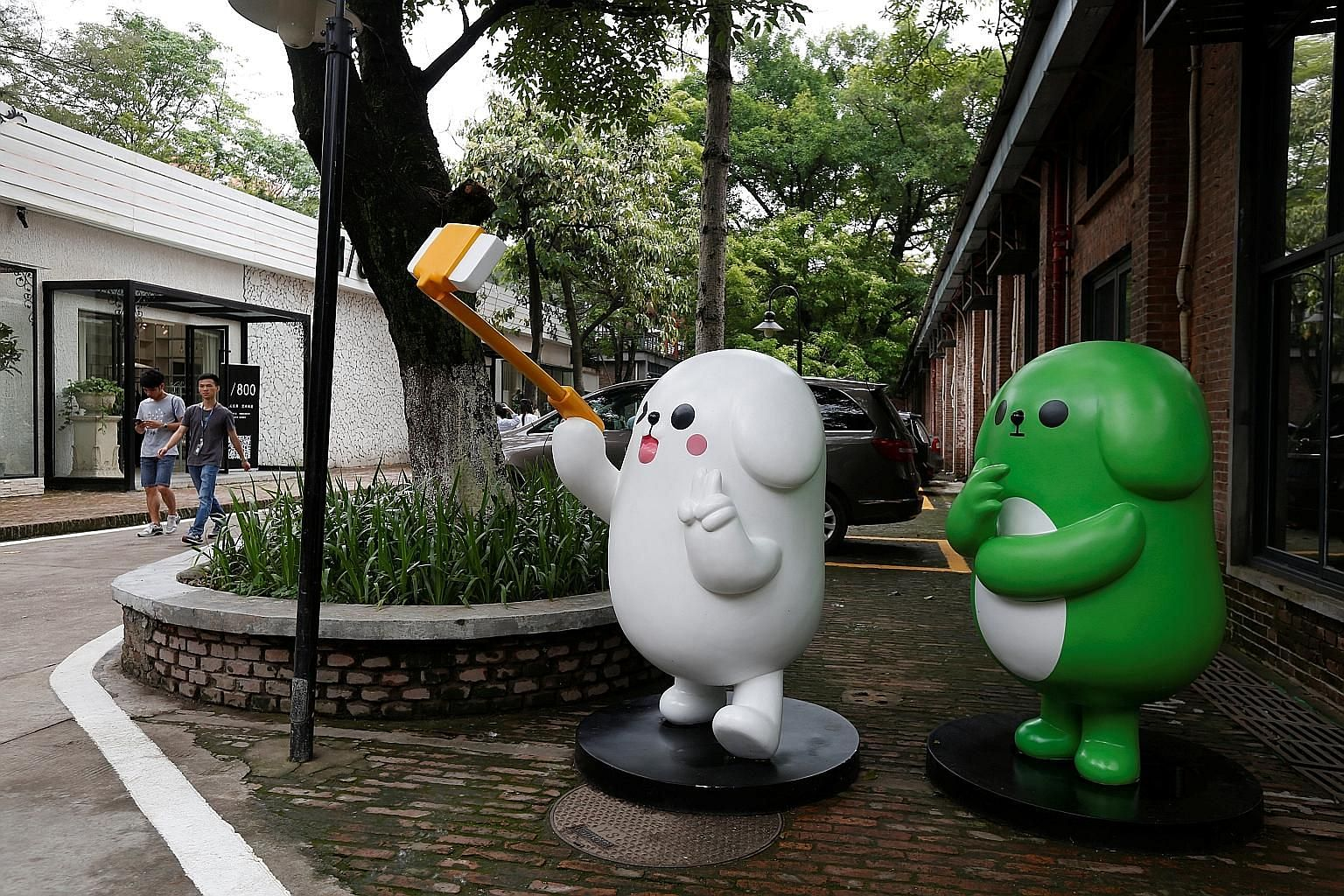 WeChat mascots on display near Tencent's office in Guangzhou. The Internet giant listed in Hong Kong, but other hot New Economy firms seem to be looking outside the region for their IPOs, which has Asian exchanges scrambling to find ways to woo their