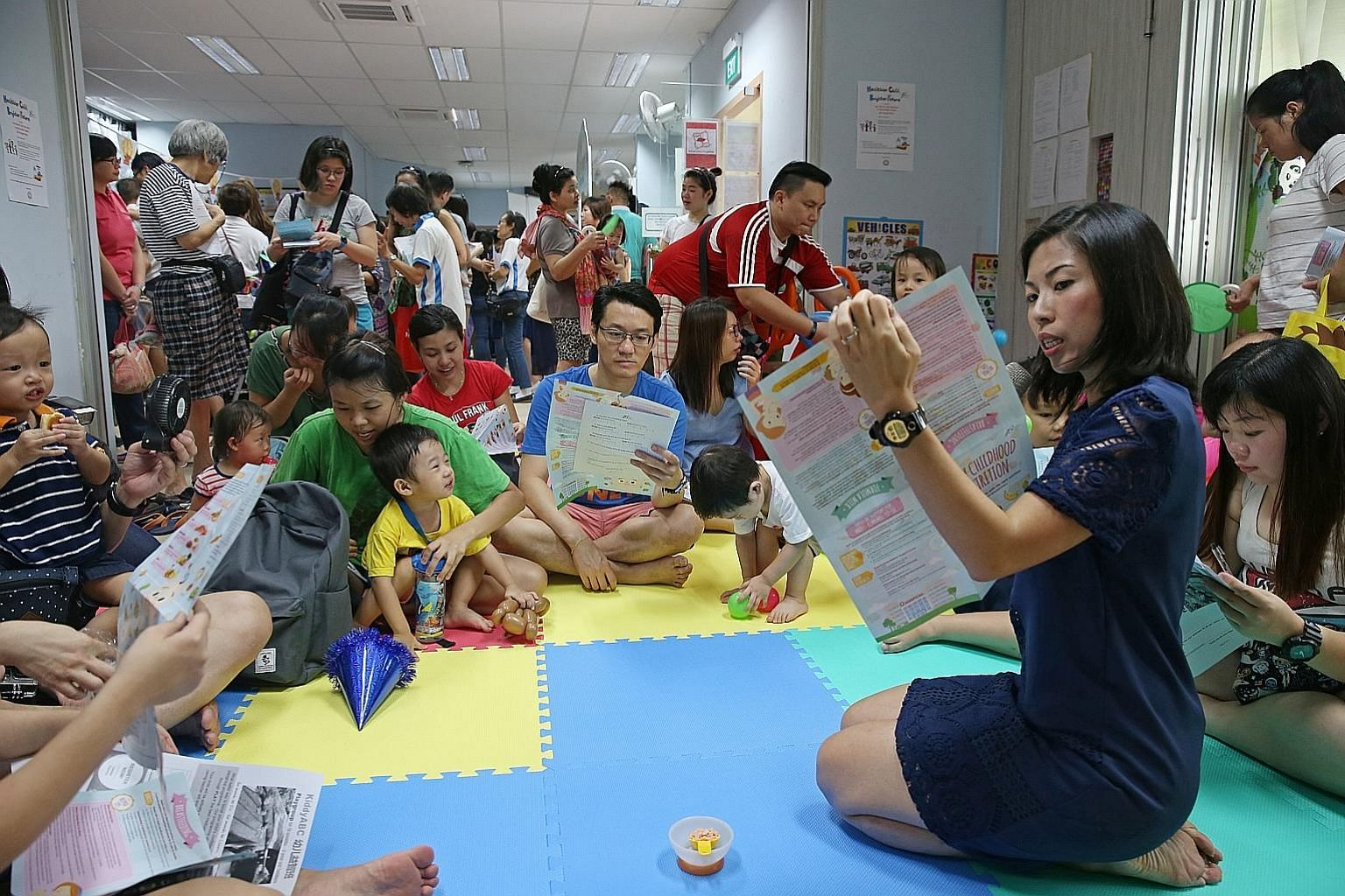 A nutritionist from the Health Promotion Board, Ms Jolyn Wong, 36, giving a talk at the Embracing Parenthood event held at Punggol Seas RC yesterday.