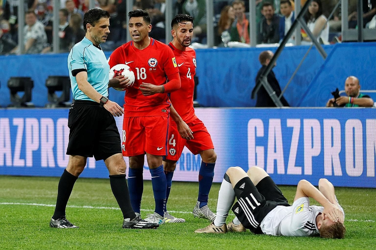 Referee Milorad Mazic ended up cautioning Chile's Gonzalo Jara (No. 18) after a video review of his challenge on Germany's Timo Werner.