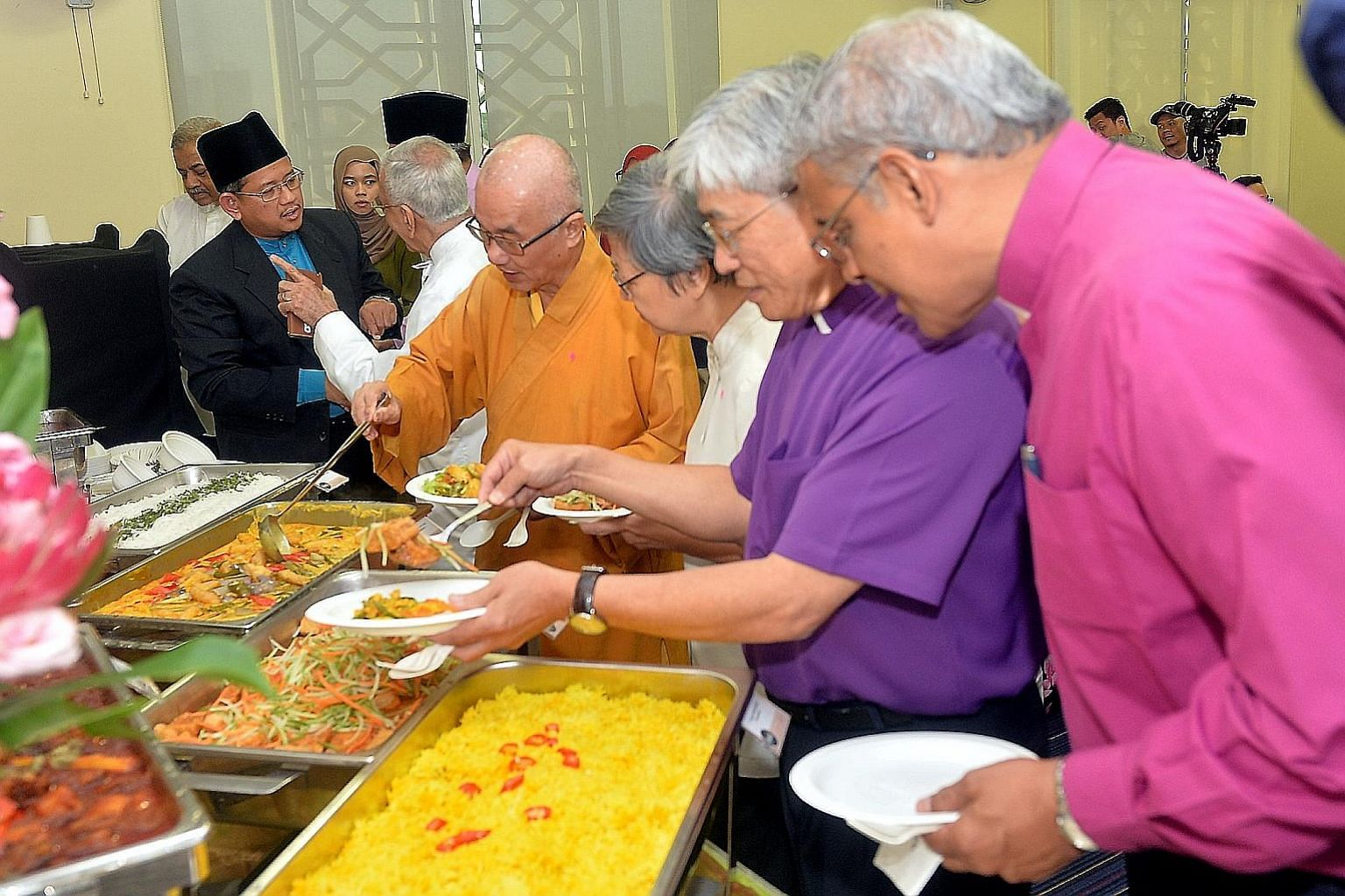 At yesterday's event are (from left at table) Mufti Fatris Bakaram, Inter-Religious Organisation president and Parsi Zoroastrian Association president Rustom Ghadiali, Buddhist Federation president Seck Kwang Phing, Roman Catholic Church's Sister Mar