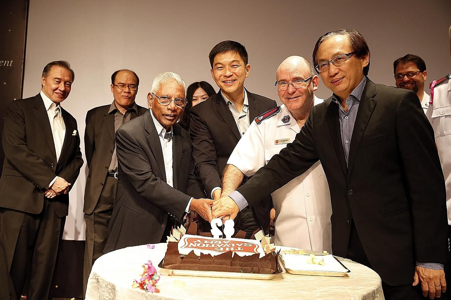 At the dinner yesterday were (front, from left) former minister S. Dhanabalan, patron of The Salvation Army; Mr Tan Chuan- Jin, Social and Family Development Minister; Colonel Lyndon Buckingham, Territorial Commander, The Salvation Army; and Mr Bill