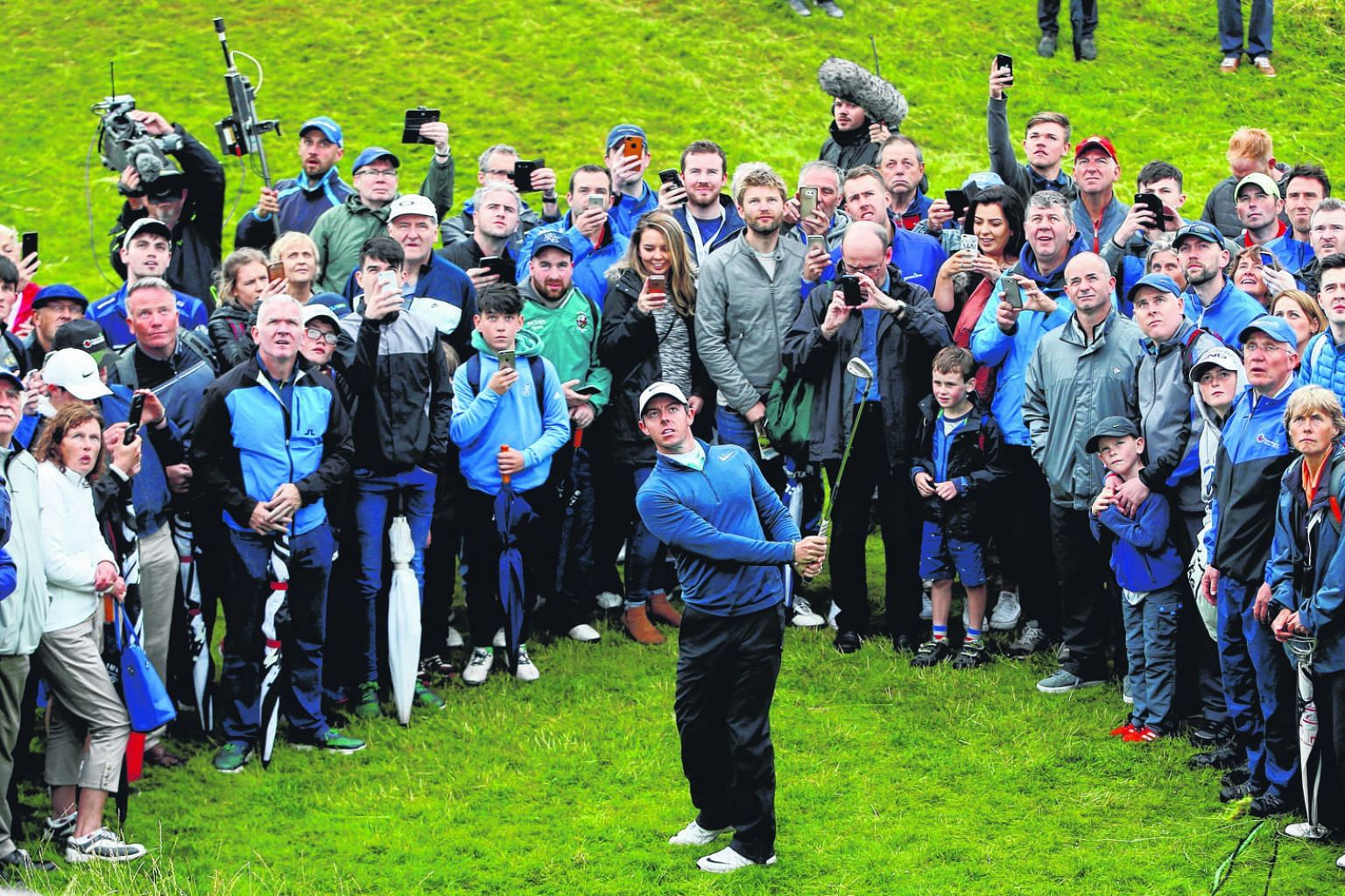 The passionate Portstewart crowd watching Rory McIlroy play out of the rough in the second round. He needs to improve quickly for the Open.