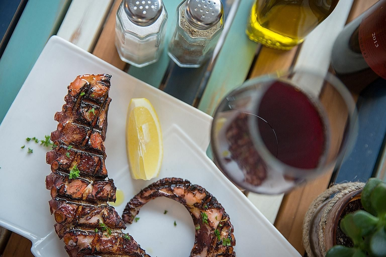 The grilled octopus (above) is tender with an appealing aroma of smoke and oregano and the Greek yogurt topped with honey and walnuts (left) is delicious.