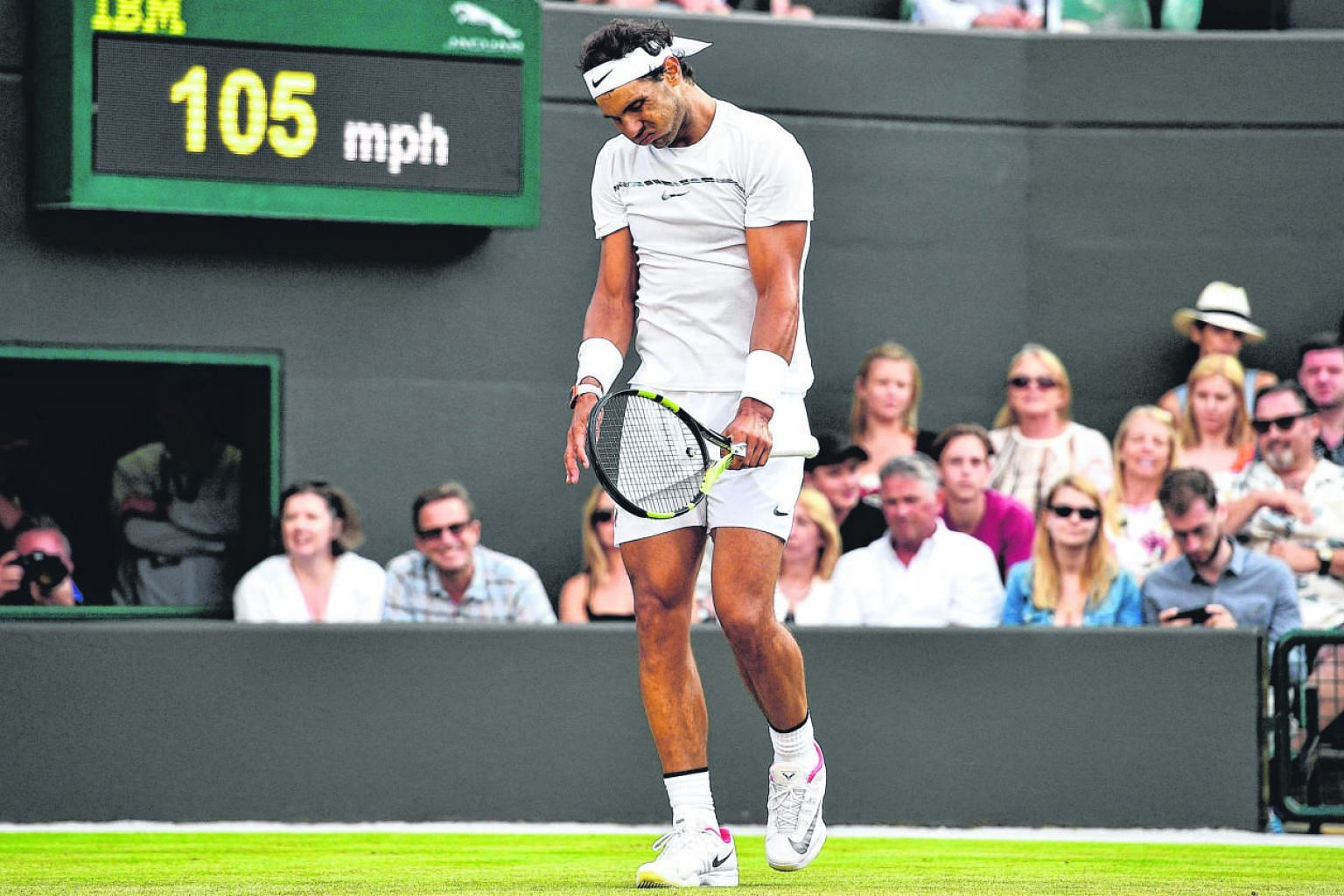 Rafael Nadal showing his frustration after losing a point to Luxembourg's Gilles Muller during their fourth round match at Wimbledon.