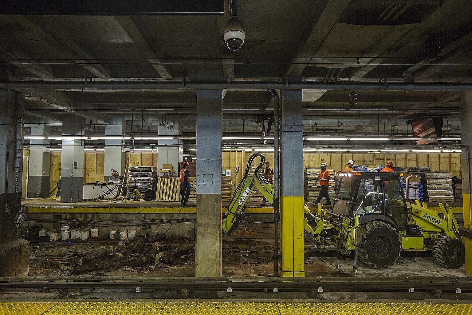 The widely dreaded first day of intensive track repairs at New York's Pennsylvania Station in Manhattan, the busiest terminal in North America, turned out to be far less hellish than forecast, but New York City's hardened commuters were reluctant on