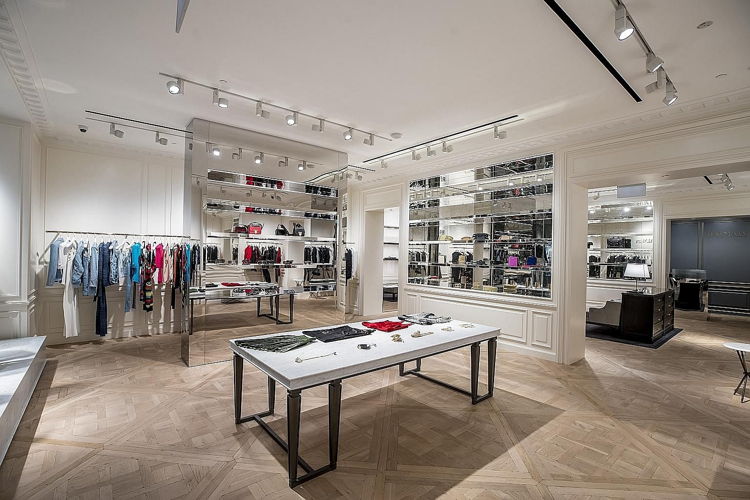Located at The Shoppes at Marina Bay Sands, the store (left) opens tomorrow.