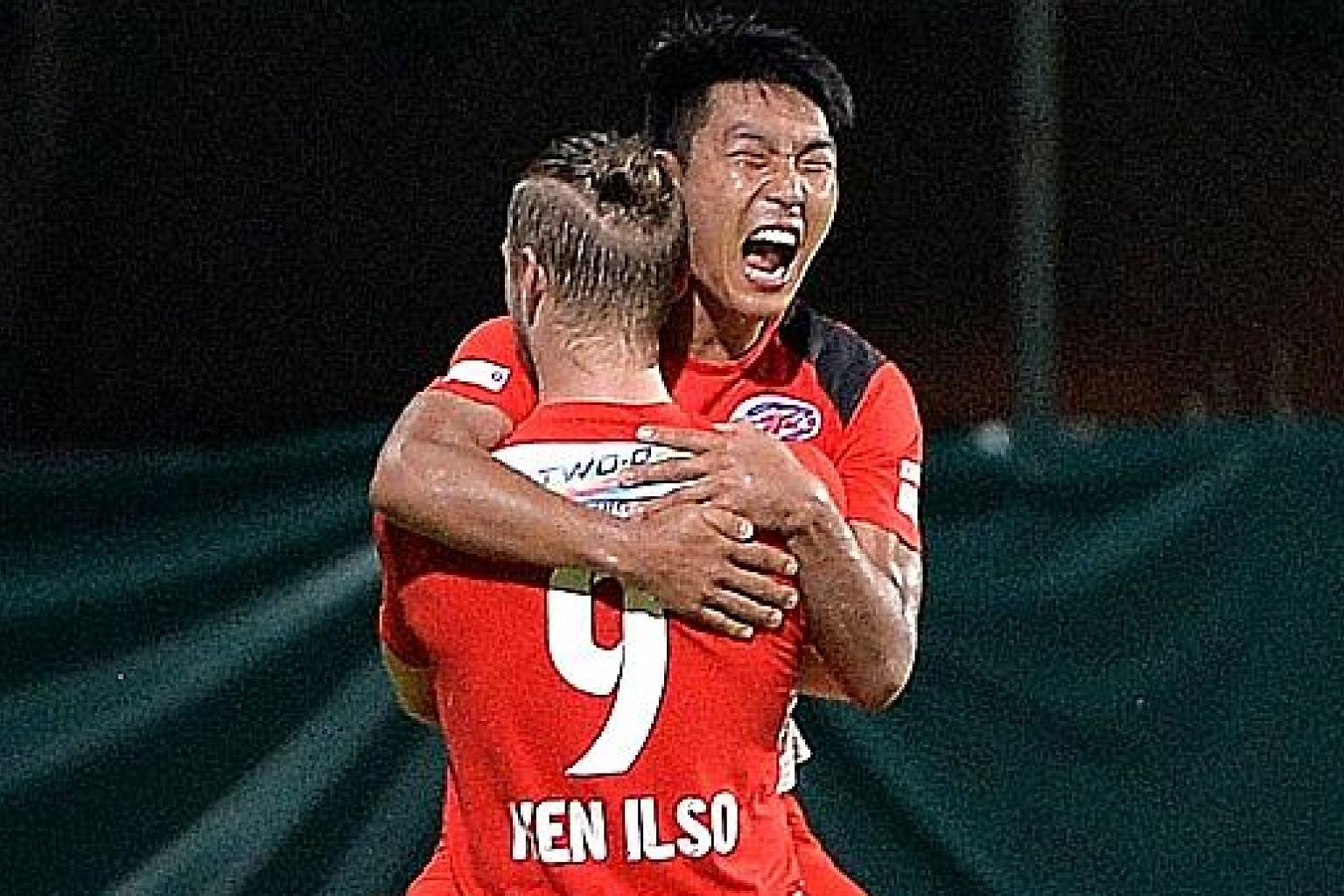 "Song Ui Young celebrating with then team-mate Ken Ilso during Home's 3-0 S-League win over Warriors last August. Coach Aidil Sharin says the 23-year-old ""is a complete player - both in attack and defensively""."