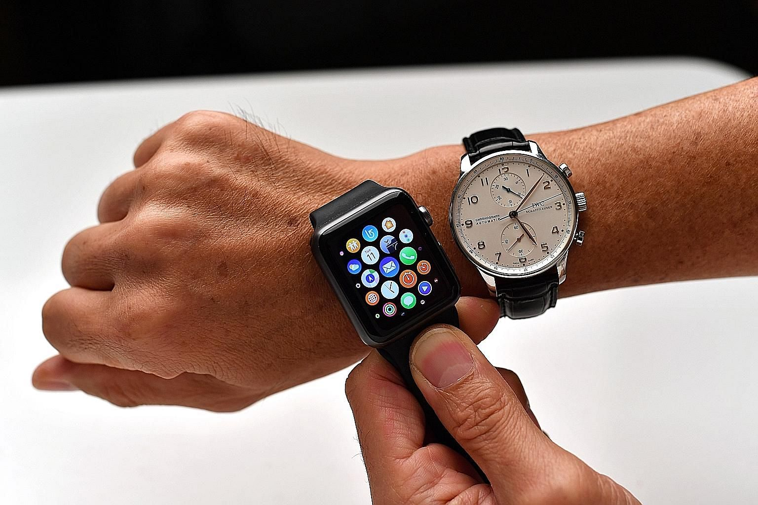 Smartwatches such as the Apple watch (above left) have multiple functions and tell time more accurately while mechanical watches such as the $12,000 IWC timepiece (right) are known for their engineering and artistic expression. Luxury brands that hav