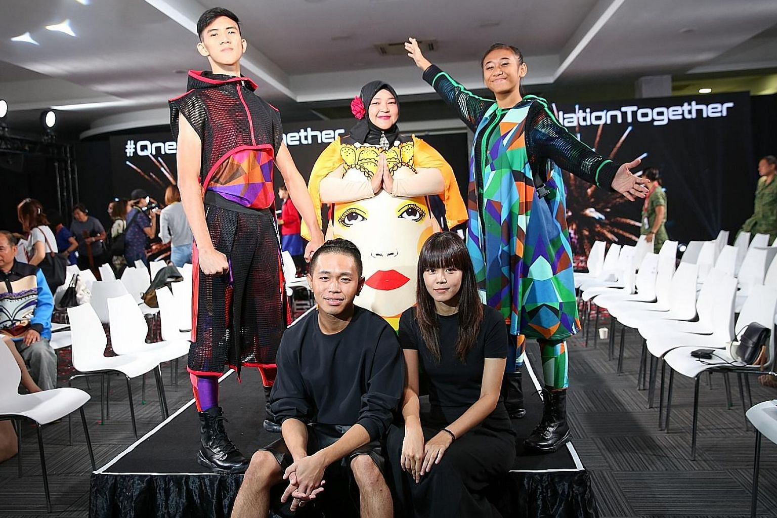 Mr Max Tan and Ms Yuan Zhiying, who are designing for the National Day Parade for the first time, have 140 designs which have been used to produce about 3,000 pieces.