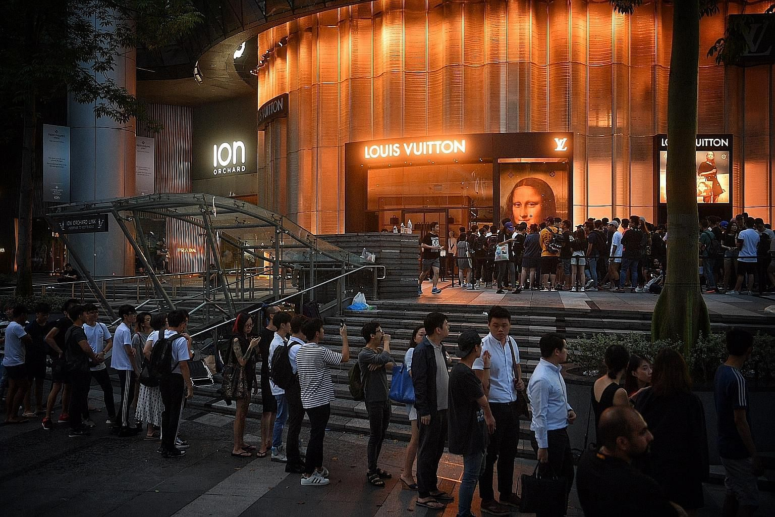 The queue to get a raffle ticket for early access to the Louis Vuitton limited-edition collaboration with streetwear label Supreme outside the Louis Vuitton store at Ion Orchard at 7am yesterday.