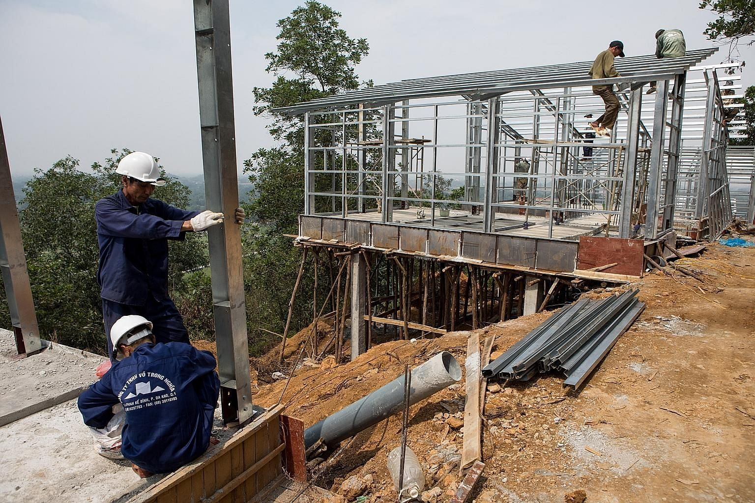 Builders construct two models of the S House, designed by architect Vo Trong Nghia, in Hanoi, Vietnam, in April.