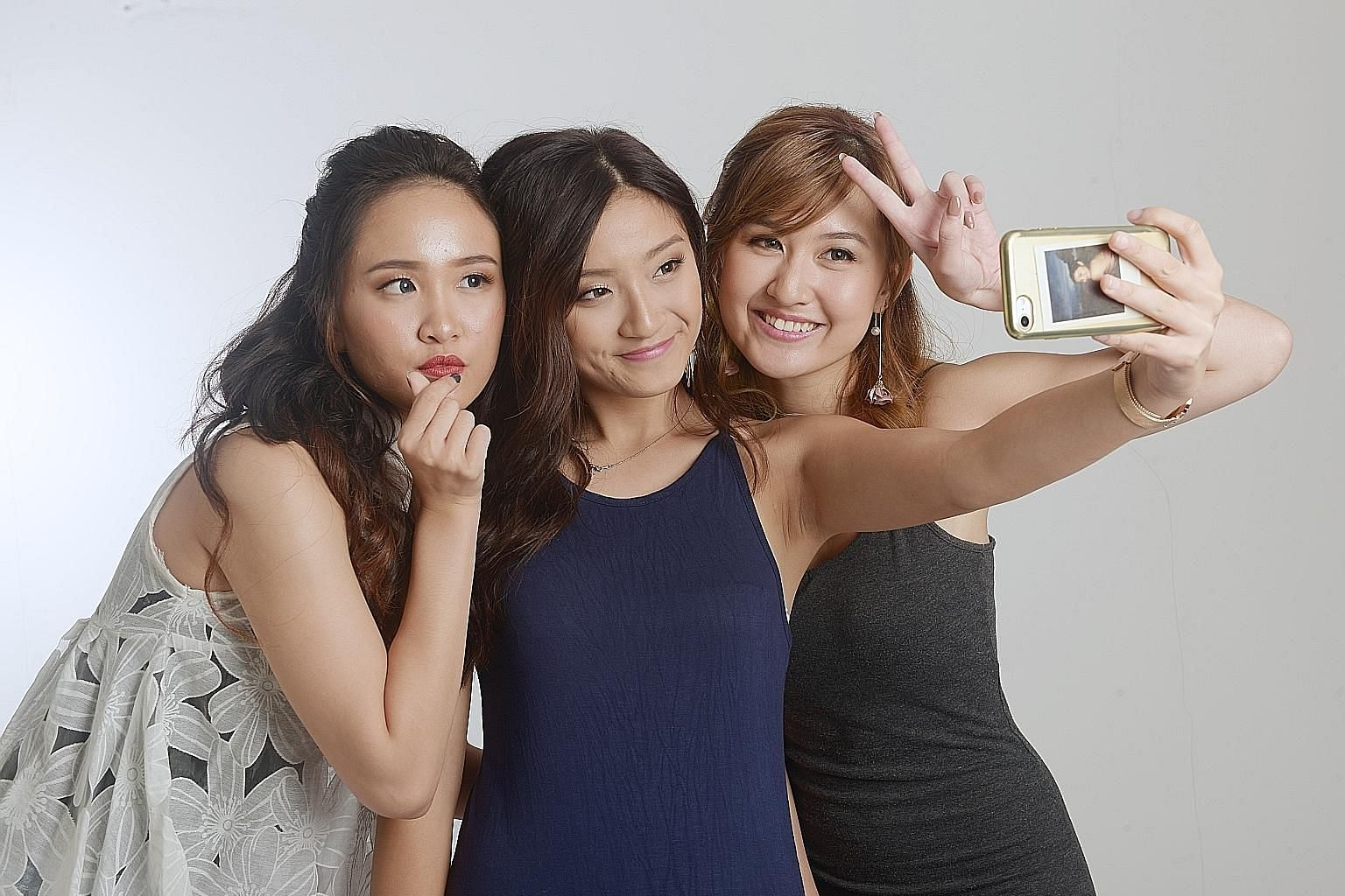 Singaporean contestants (from left) Christina Cai, Queenie Sia and Tricia Koh. The trio were among 16 out of 19 finalists who drew flak from netizens after an unofficial photo of them was posted online. Some have questioned if organiser REM Singapore