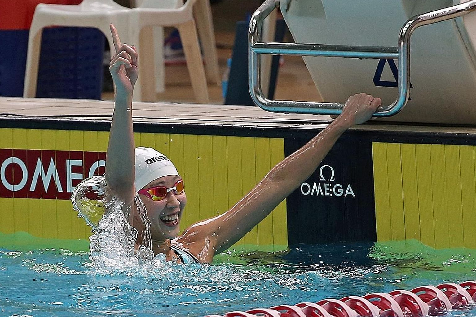 An elated Cherlyn Yeoh after winning the 100m freestyle.