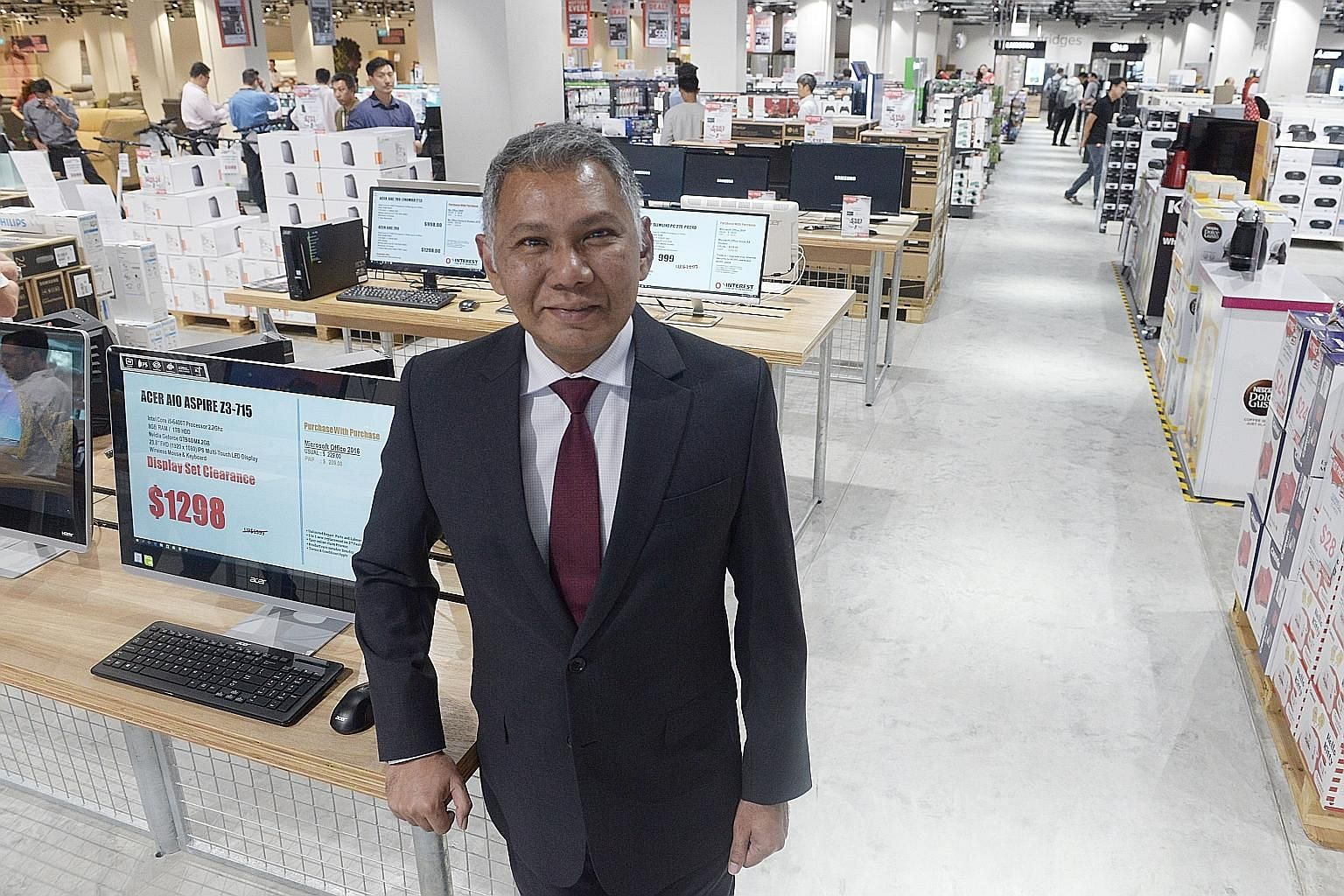 Mr Kenneth Aruldoss at the opening of Harvey Norman's two-storey, 38,500 sq ft factory outlet in Chai Chee Road last Saturday.