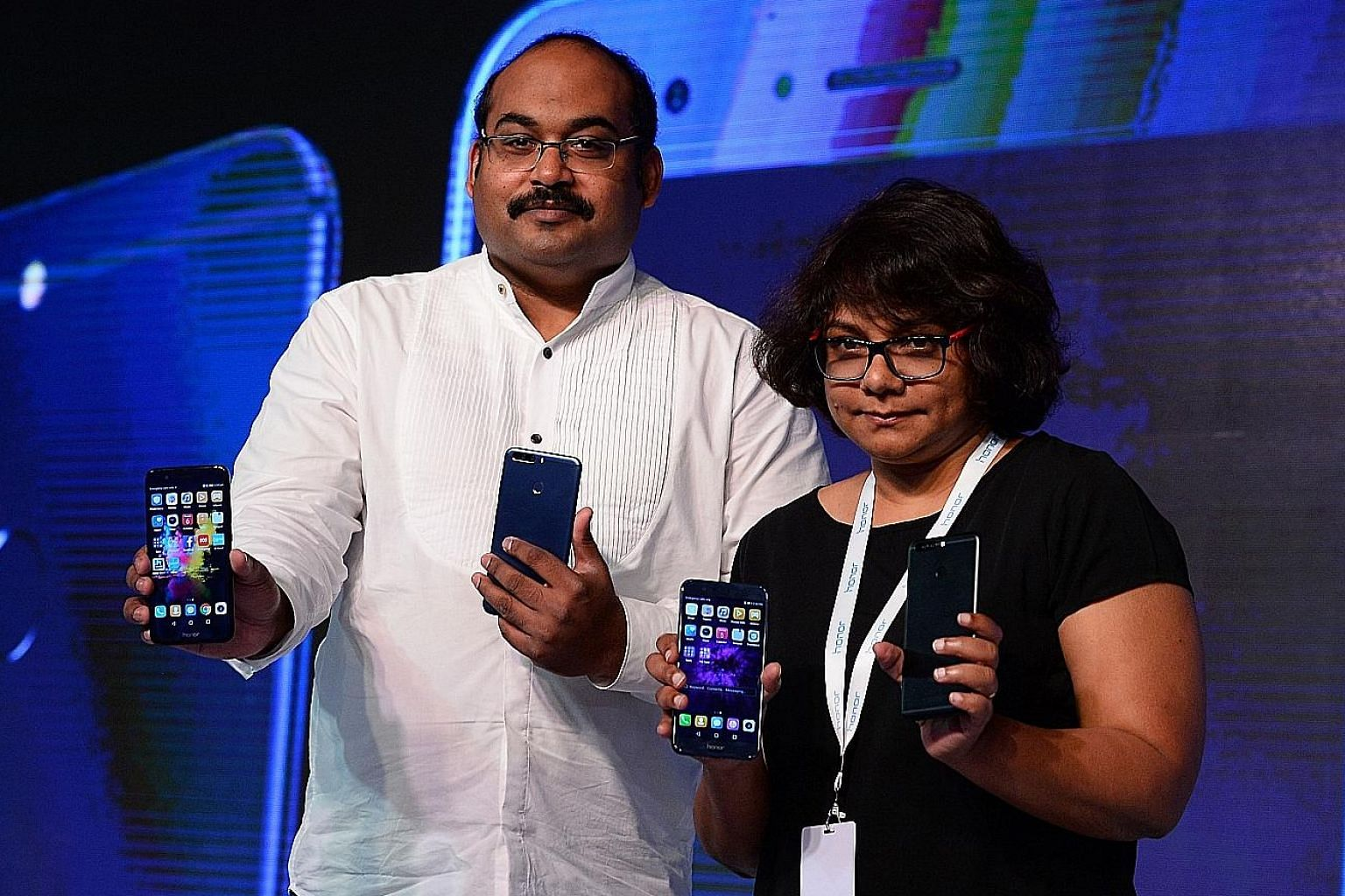 Mr P. Sanjeev, vice-president of sales for Huawei India's consumer group, and Ms Shalini Puchalapalli, director of category leadership at Amazon, with Huawei's new Honor 8 Pro smartphone in New Delhi.