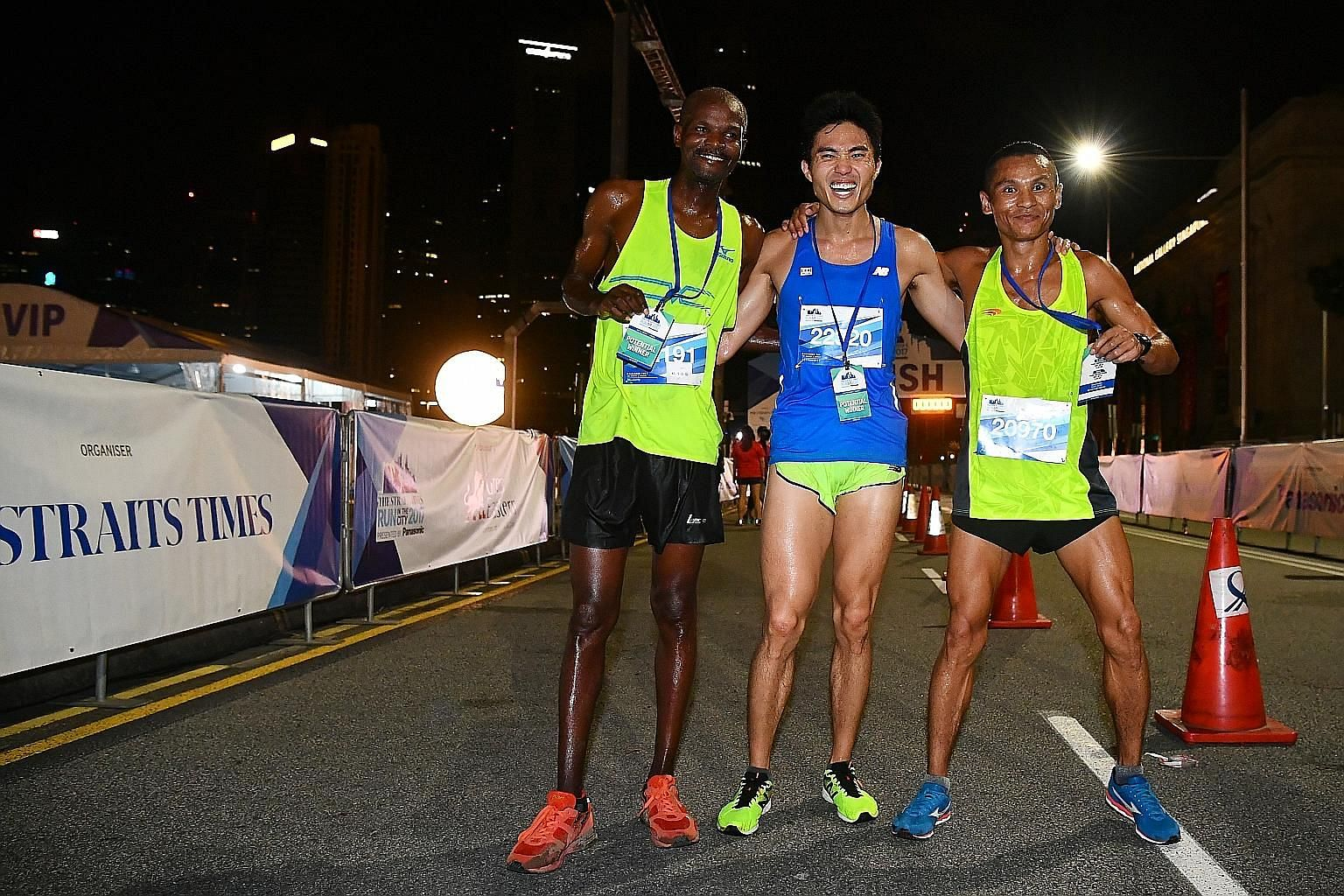 The top three male runners in the ST Run's signature 18.45km race are (from left) Kenyan James Karanga, the winner; Singaporean Mok Ying Ren, who took third place; and Nepali Nimesh Gurung, who was second.