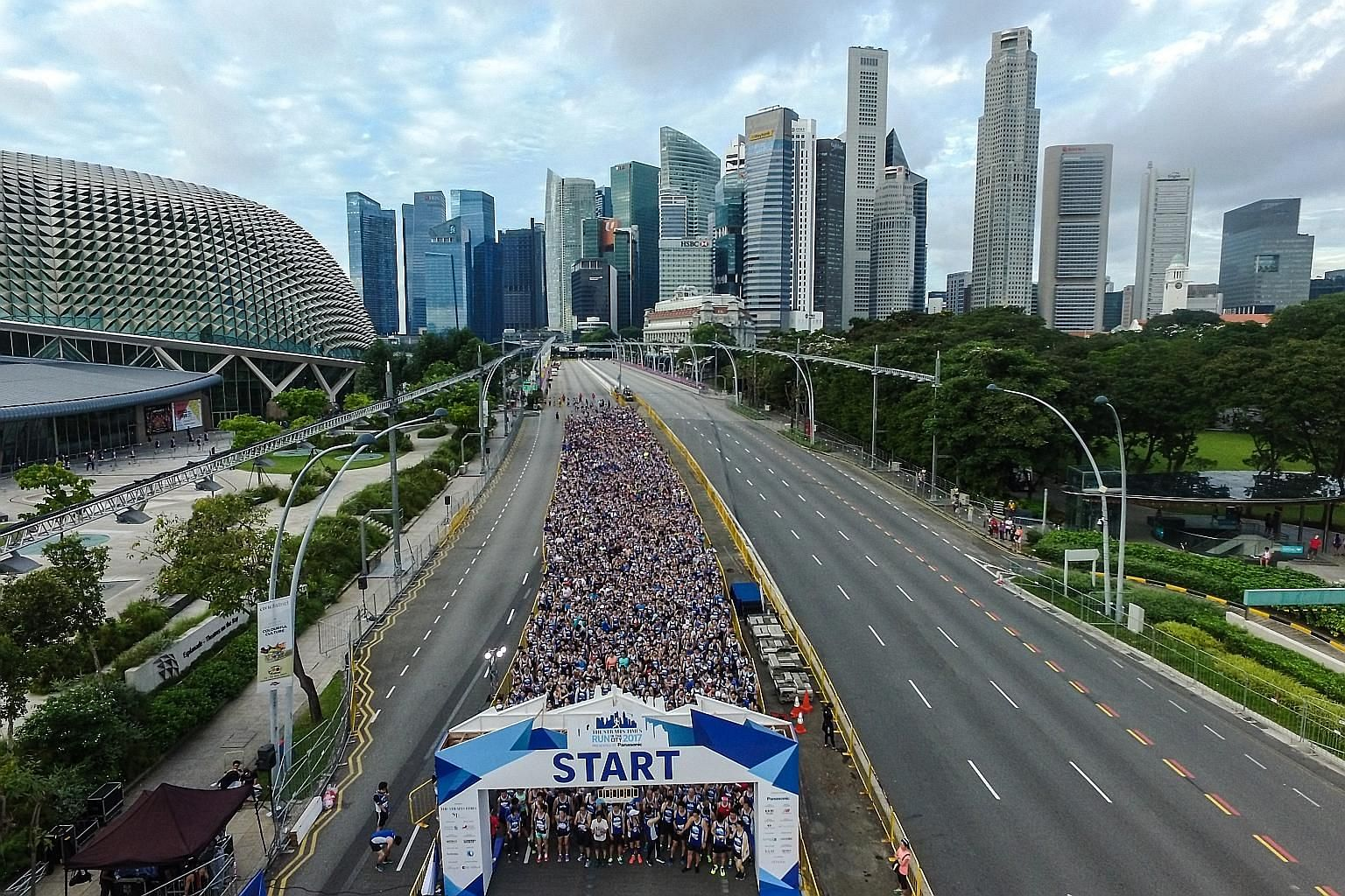 Runners of the 5km race on Esplanade Drive yesterday. This year, the ST Run culminated at the Padang, where a post-race carnival was held.