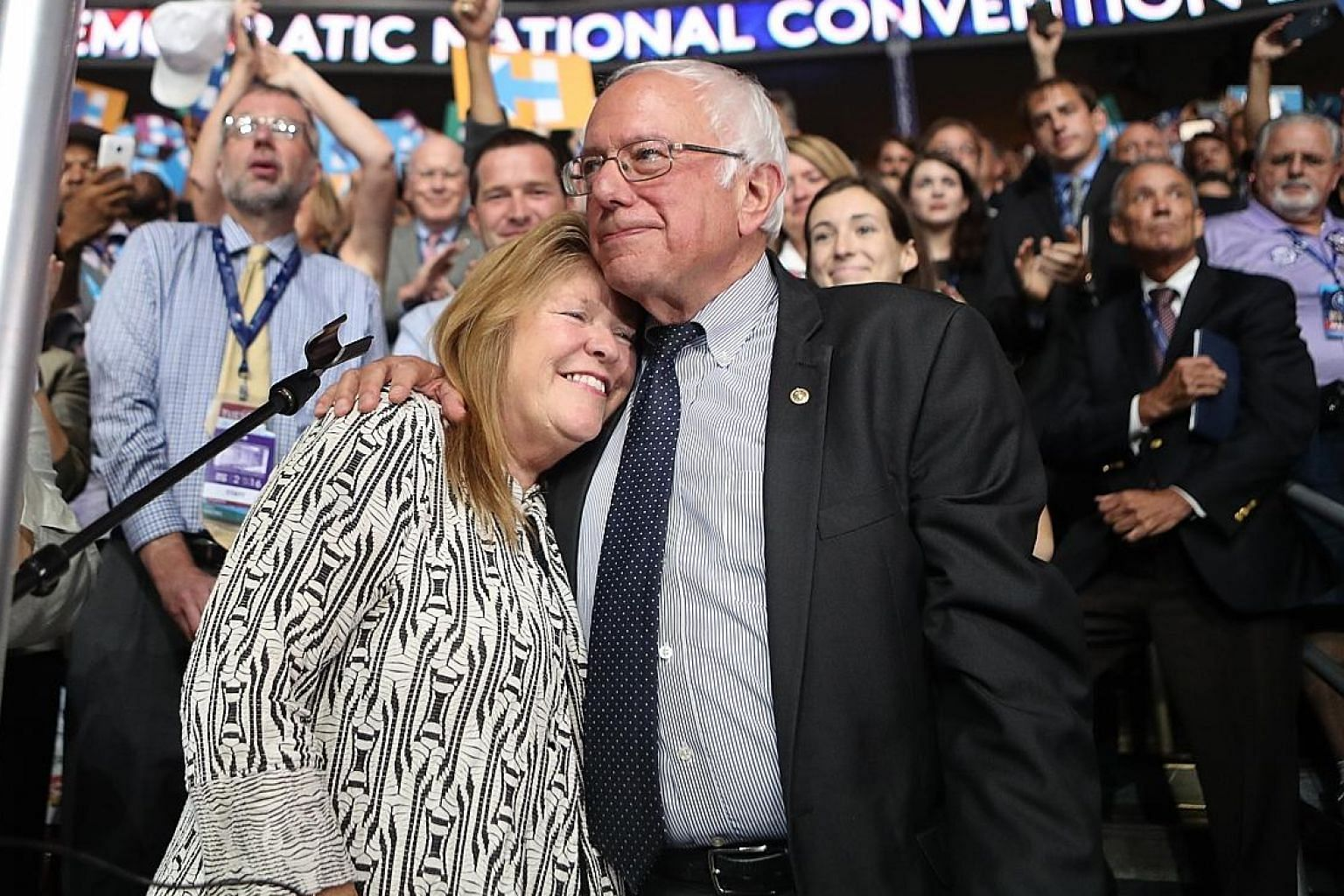 Senator Bernie Sanders and his wife, Jane, at last year's Democratic National Convention. Though Mr Sanders is still riding high on popularity from his presidential bid, he has been shadowed by talk of a federal probe into his wife's role in a 2010 l