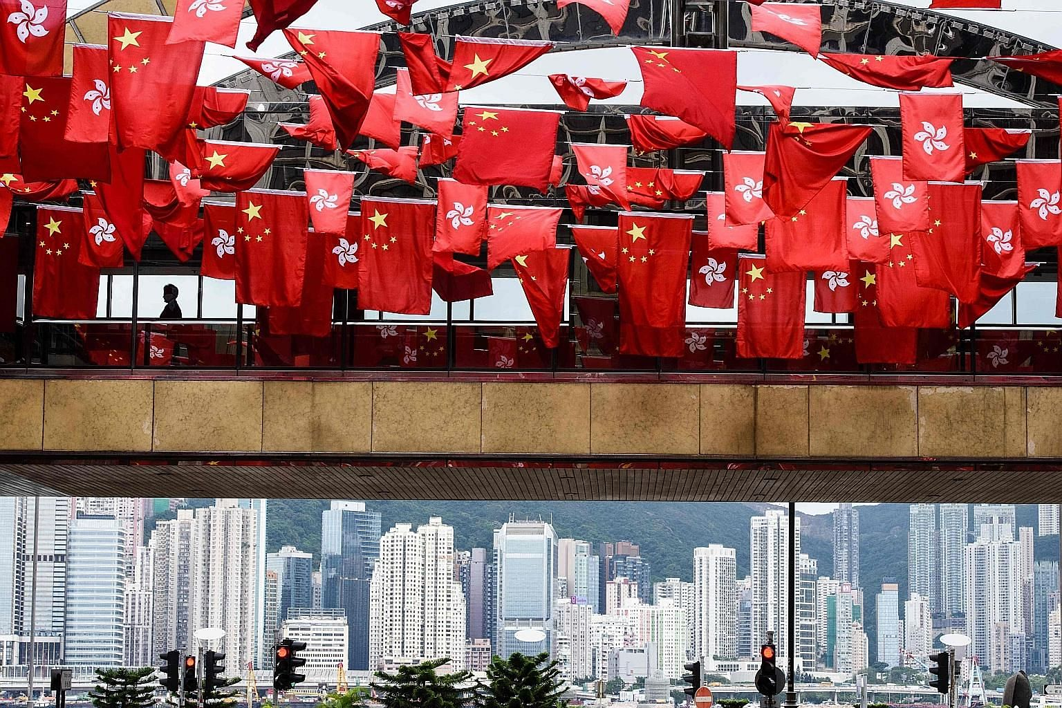 Hong Kong and China flags adorning buildings across the city to mark the 20th anniversary of its handover to China by Britain. In 30 years' time, Hong Kong will fully revert to the mainland.