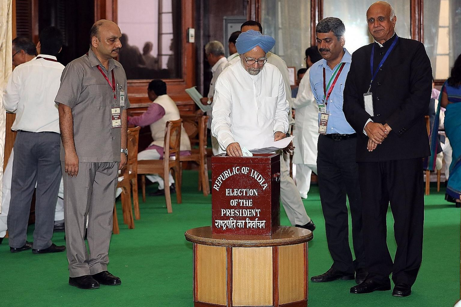 Former Indian prime minister Manmohan Singh casting his vote at Parliament House in New Delhi yesterday to elect the country's 14th president, a largely ceremonial post that is being contested by ruling BJP candidate Ram Nath Kovind and opposition Co