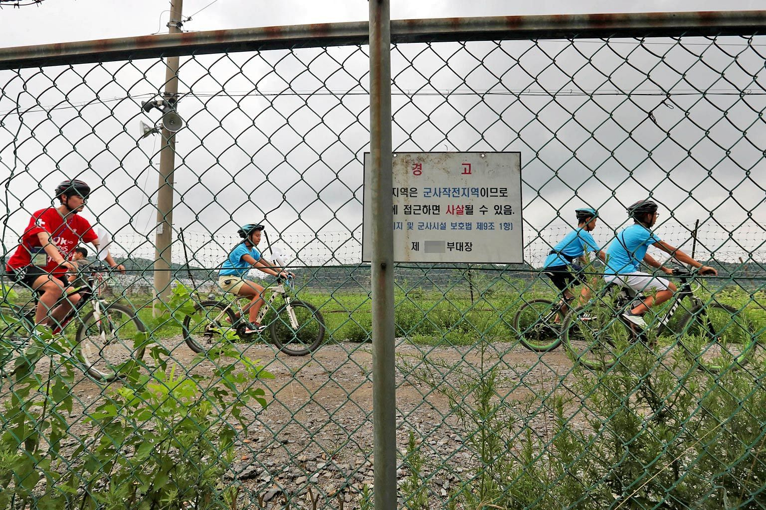 People cycling yesterday near Paju, north of Seoul, along the demilitarised zone separating the two Koreas, at an event to promote inter-Korea peace. Seoul has proposed a meeting to be held on Friday.