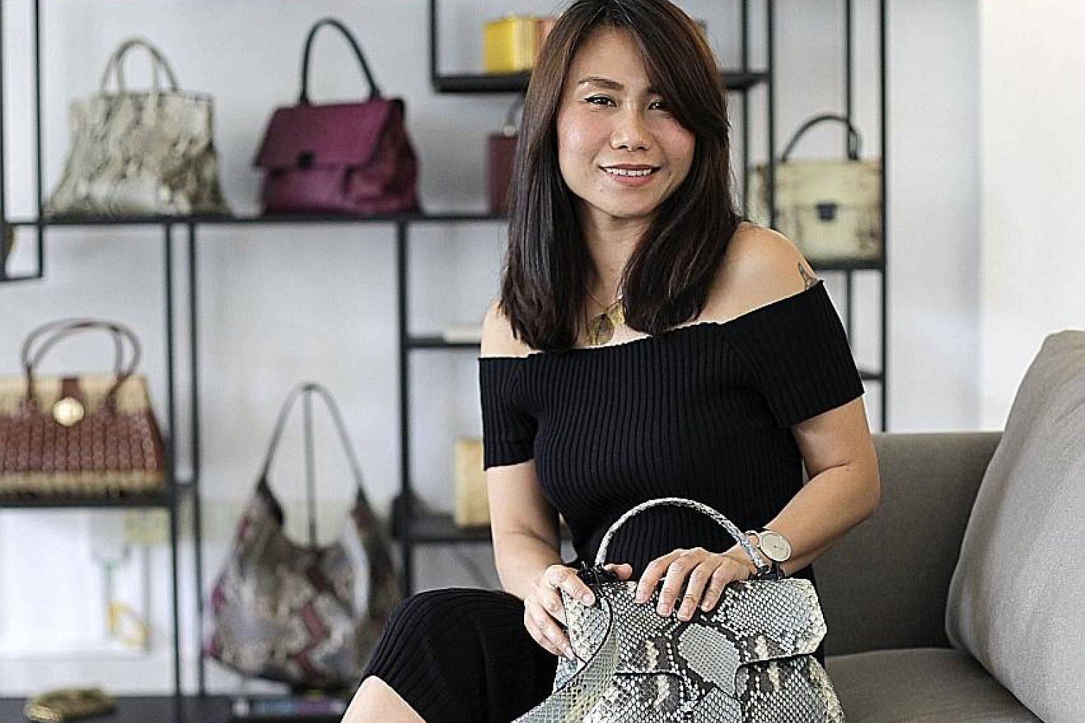 Bag designer Goh Ling Ling's showroom is where customers can browse her leather bags while sipping on a drink.
