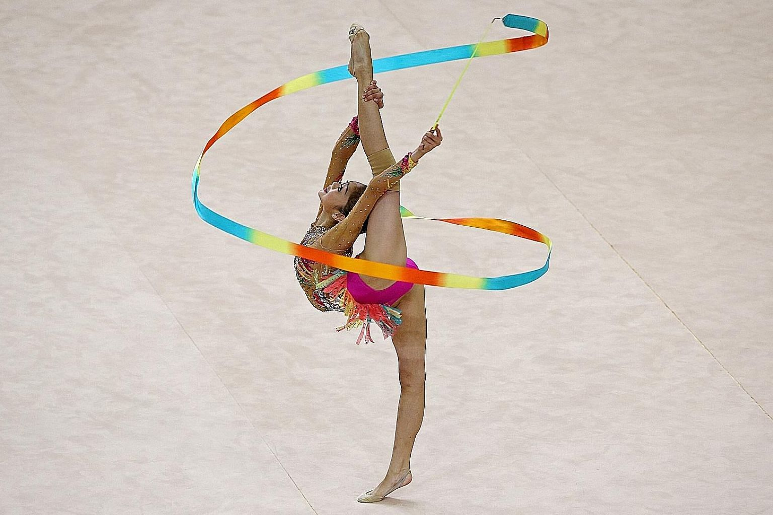 Malaysia's Izzah Amzan performing her ribbon routine at the Bishan Sports Hall. She scored 13.617 points in the final to win gold. The 17-year-old was the star of the Asean Schools Games rhythmic gymnastics competition, winning four golds.