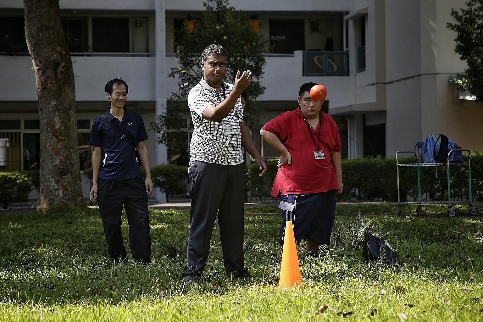 Mr Md Arif Mohd Hassan, 28, who has moderate intellectual disability, playing bocce at a park near the Movement for the Intellectually Disabled of Singapore's (Minds) Clementi Training and Development Centre. Groups like Minds are labelled as volunta
