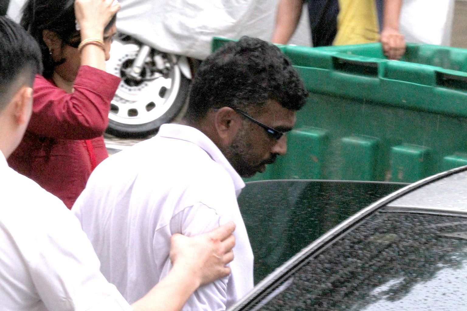 P. Mageswaran being escorted to the scene of the crime by police on Dec 23, 2013. He was spared life imprisonment as his case did not fall within the worst type of culpable homicide cases that deserved the maximum sentence.