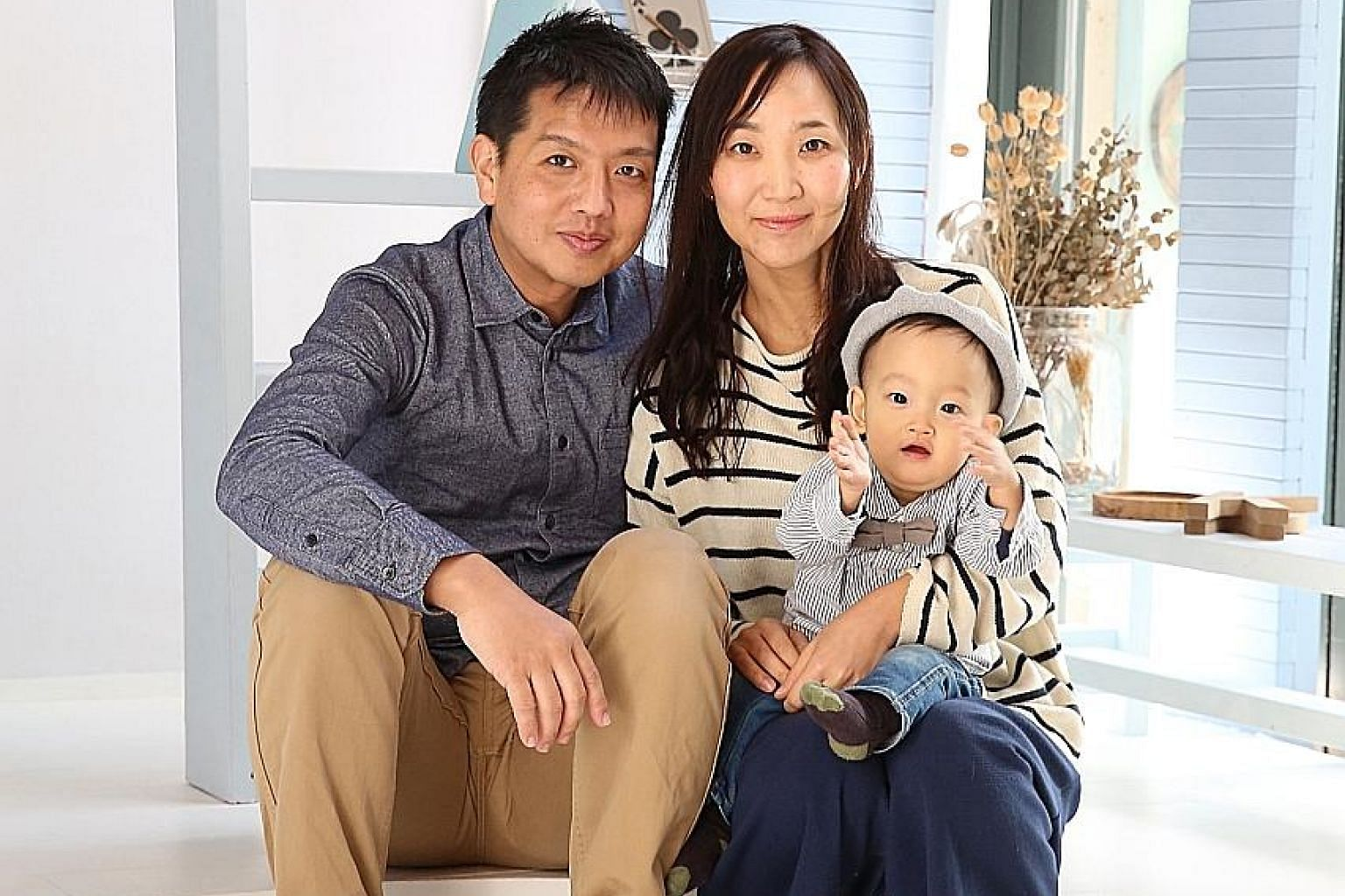 Mr Sachio Ooishi (with his wife and child) was a promising basketball player before becoming addicted to pachinko.