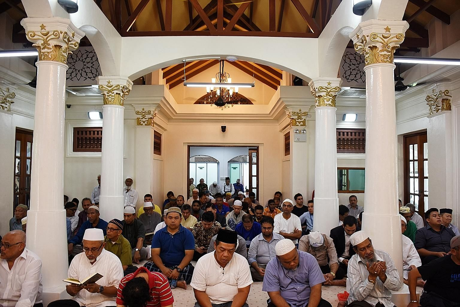 Congregants at the first Friday prayer session at Haji Muhammad Salleh Mosque's prayer hall (top), which is now air-conditioned. The stairs (above) leading to the Habib Noh shrine were also retiled.