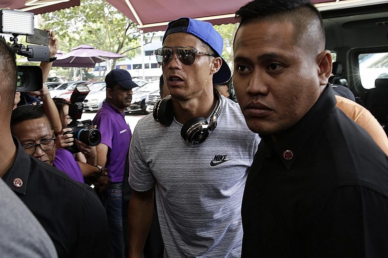 From far left: Cristiano Ronaldo at Thomson Medical Centre yesterday morning to convey his well-wishes to Singapore billionaire and Valencia owner Peter Lim.