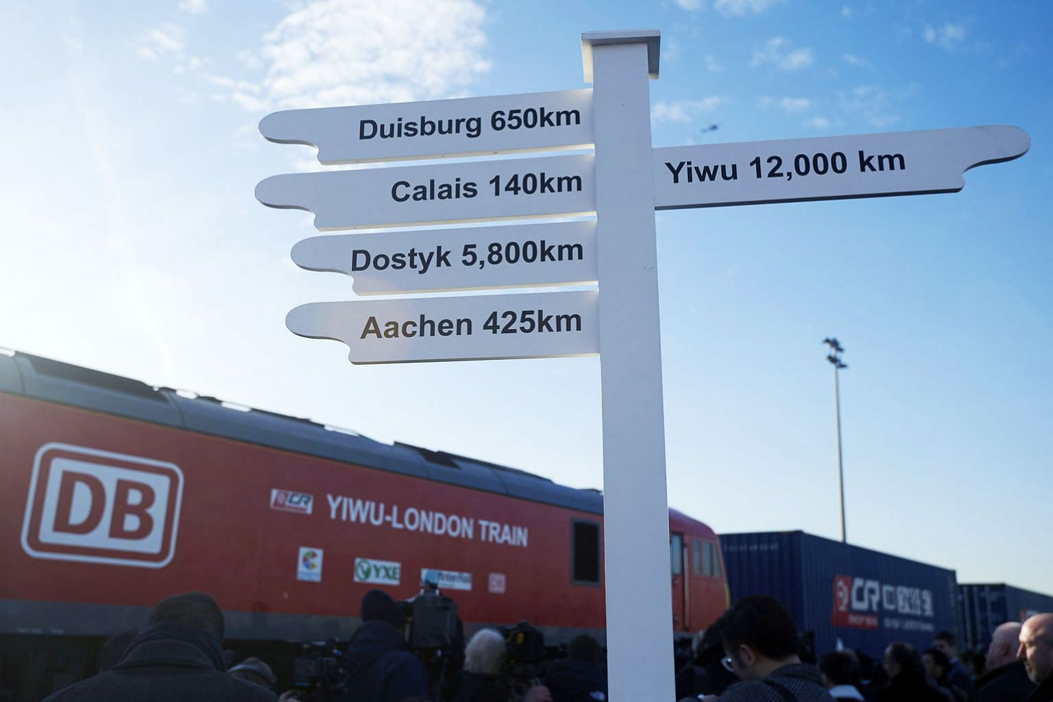 A sign showing the distance to various destinations as a freight train from China arrives at a rail freight depot in east London. The journey started in Yiwu in the eastern Chinese province of Zhejiang and is the latest effort in China's drive to str