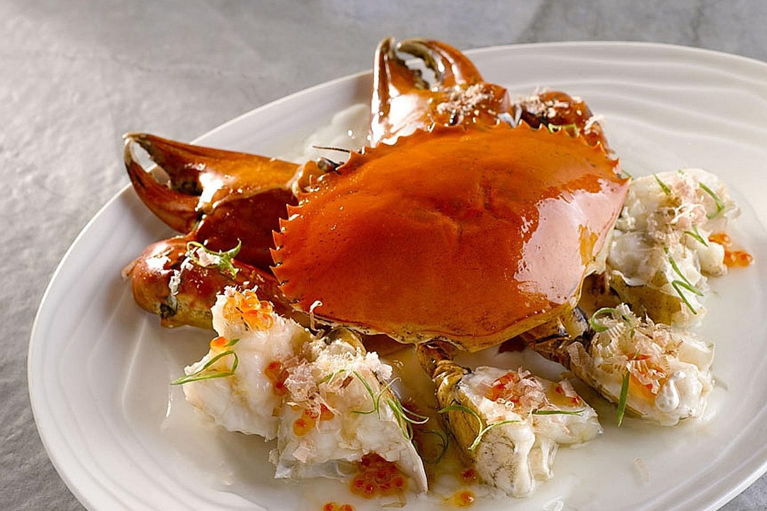 The batter in the Crispy Bull Frog With Ginger (left) is light and crispy, while the Chairman's Crab (above) is lightly seasoned, allowing the shelfish's natural sweetness to come through.