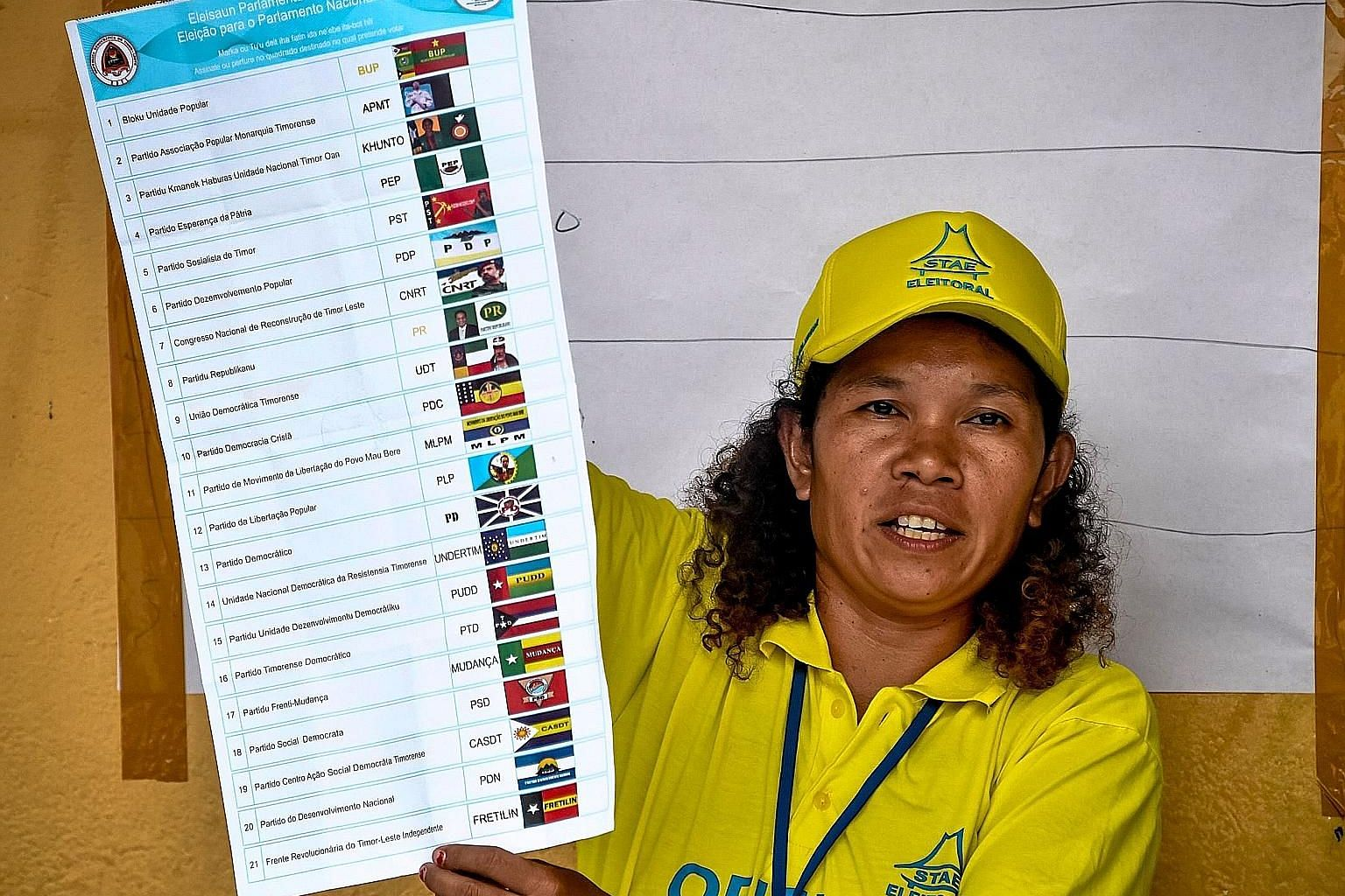 An election official showing a ballot paper in Dili yesterday, as counting begins for the parliamentary elections in Timor Leste.