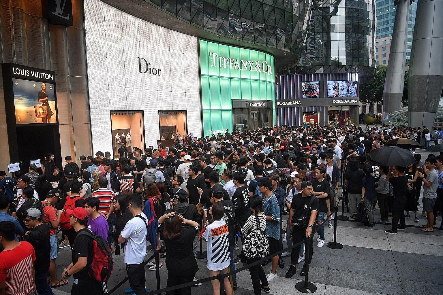 Fans queueing outside the LV store in Ion Orchard for the Supreme x Louis Vuitton collection launch on July 14. A raffle registration was held a day earlier; only those with a raffle ticket could make purchases.