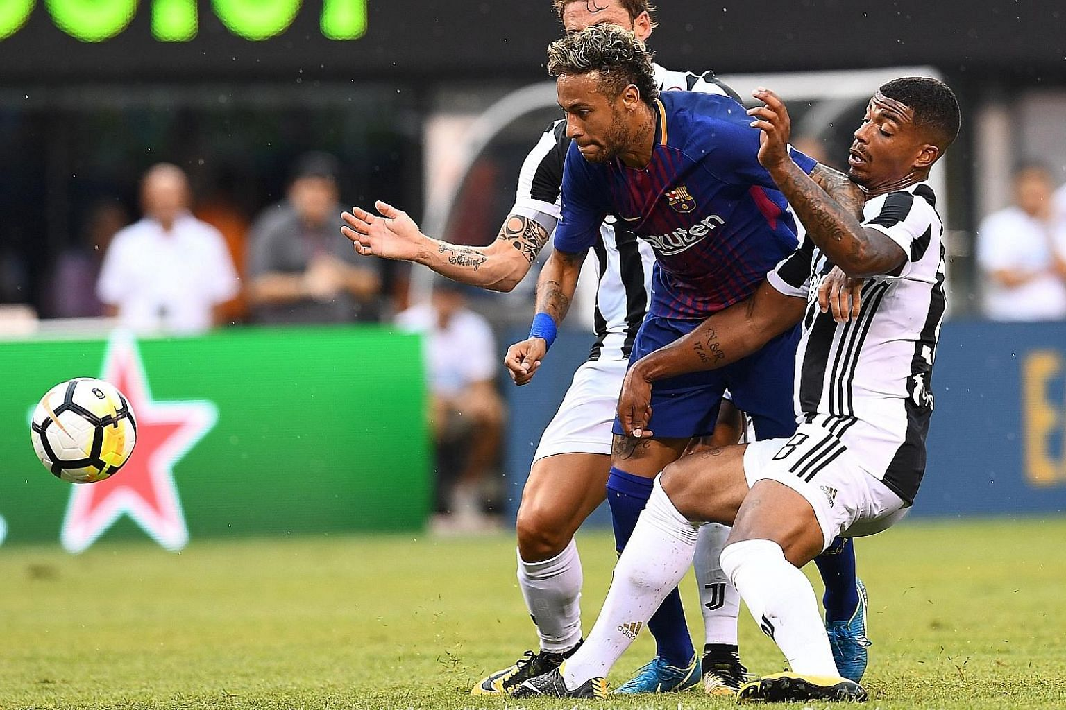 Barcelona forward Neymar vying with Juventus midfielder Mario Lemina during their ICC friendly match. The Brazilian international has been strongly tipped for a blockbuster move to French Ligue 1 side PSG.