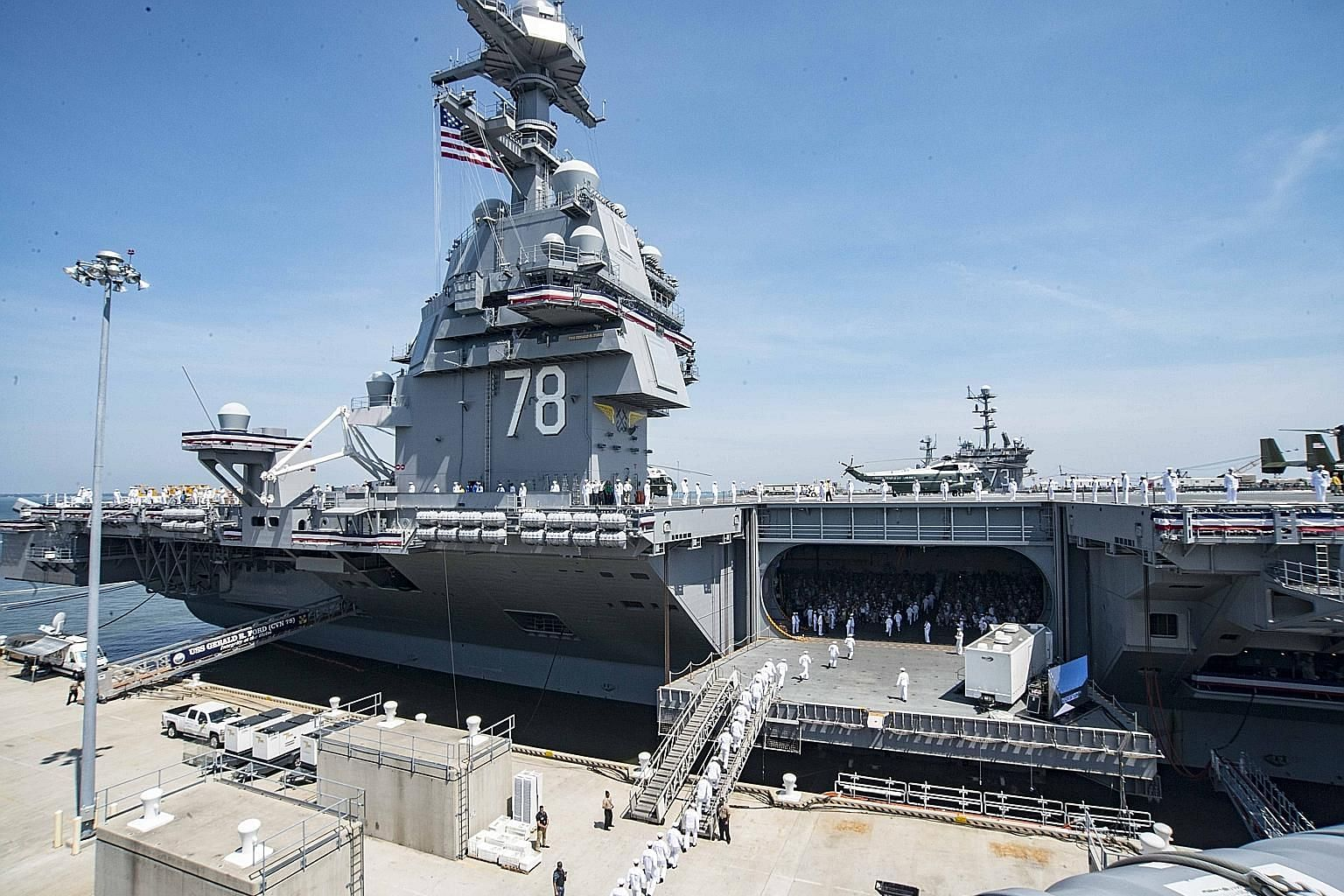 The nuclear-powered Gerald R. Ford during its commissioning last Saturday. The superstructure is smaller and farther back on the ship, allowing it to launch more flight missions a day using a new catapult and landing system.