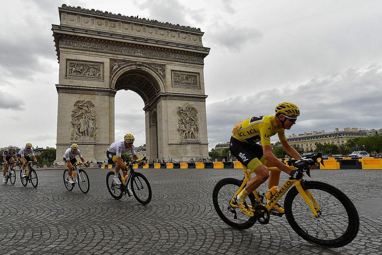 Britain's Chris Froome, in the overall leader's yellow jersey, cycling past the Arc de Triomphe during the 103km 21st and final stage of the 104th edition of the Tour de France. The Team Sky rider is now just one title behind Eddy Merckx, Miguel Indu