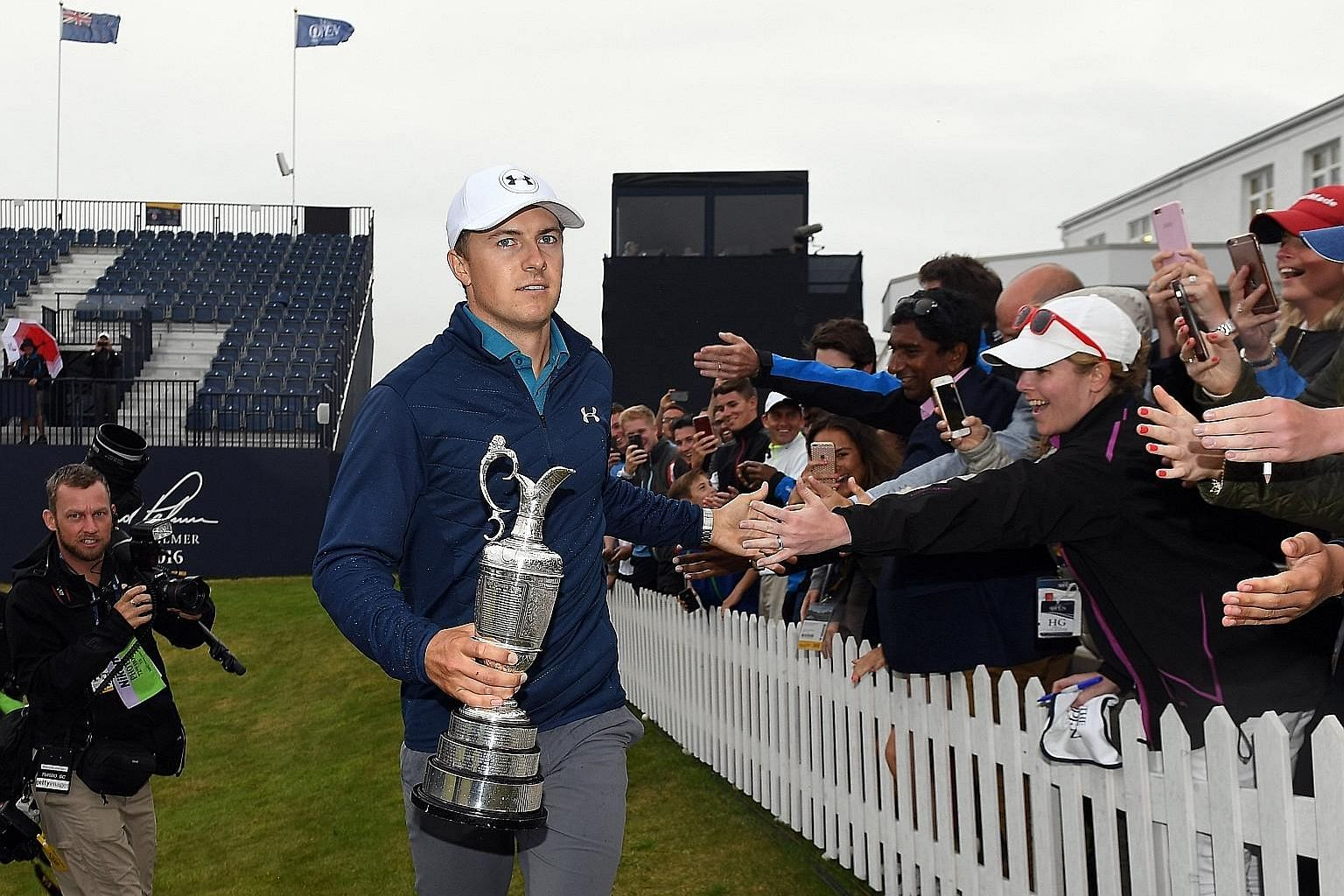 Jordan Spieth holding the Claret Jug and mingling with fans after winning the British Open at Royal Birkdale on Sunday.