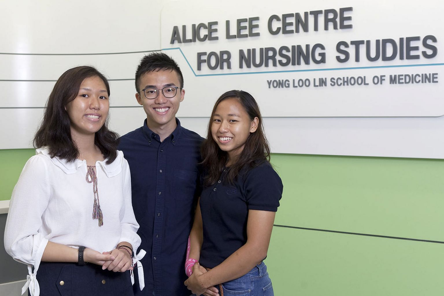 From far left: Ms Lim Xin Min, Mr Tan Jung Howe and Ms Nur Diyana Sapri are among the growing number of young people who are showing an interest in the nursing profession. NUS has seen increased demand for its Bachelor of Science, Nursing degrees.