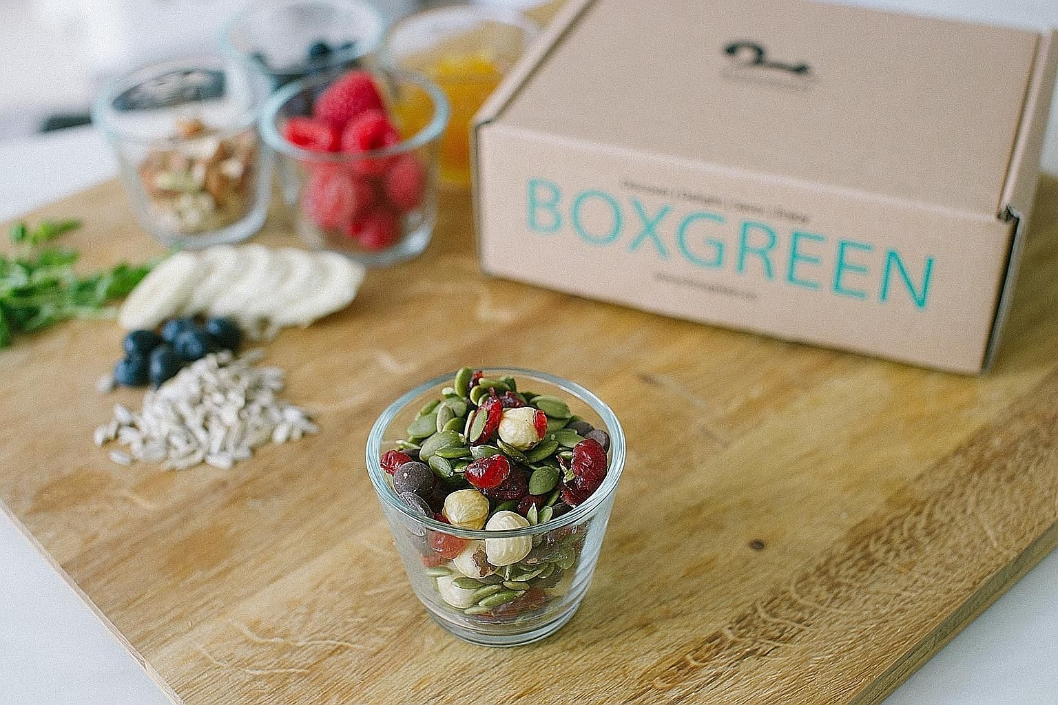 Healthy snacks from BoxGreen, one of the social enterprises at the Singapore Coffee Festival. Festival-goers can complete fun and easy socially conscious tasks at the event to redeem rewards such as an eco-friendly reusable coffee tumbler.