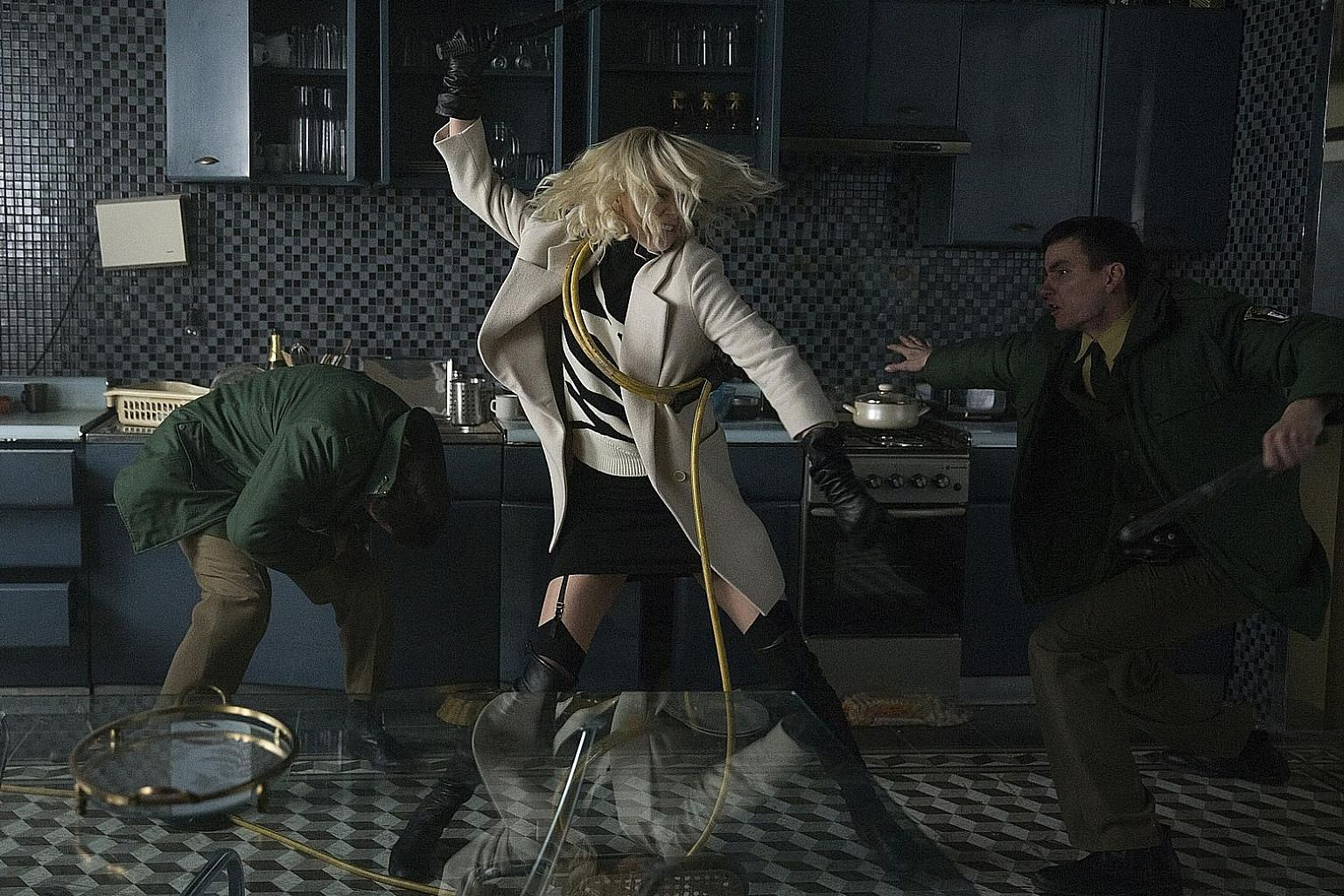 Charlize Theron (centre) as a British spy in Atomic Blonde.