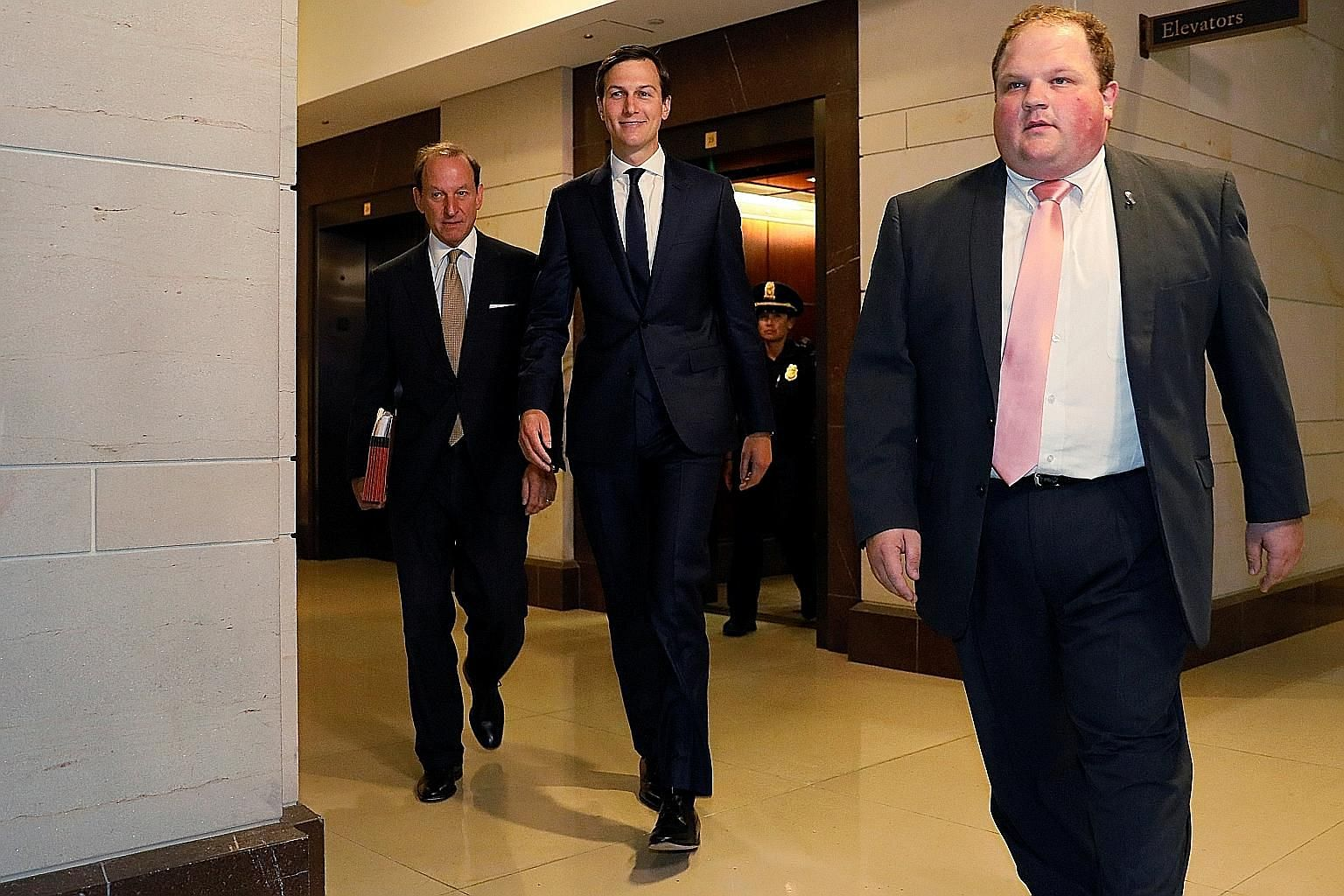 Mr Jared Kushner (centre), with his attorney Abbe Lowell (left), arriving for a House Intelligence Committee meeting on Capitol Hill yesterday.